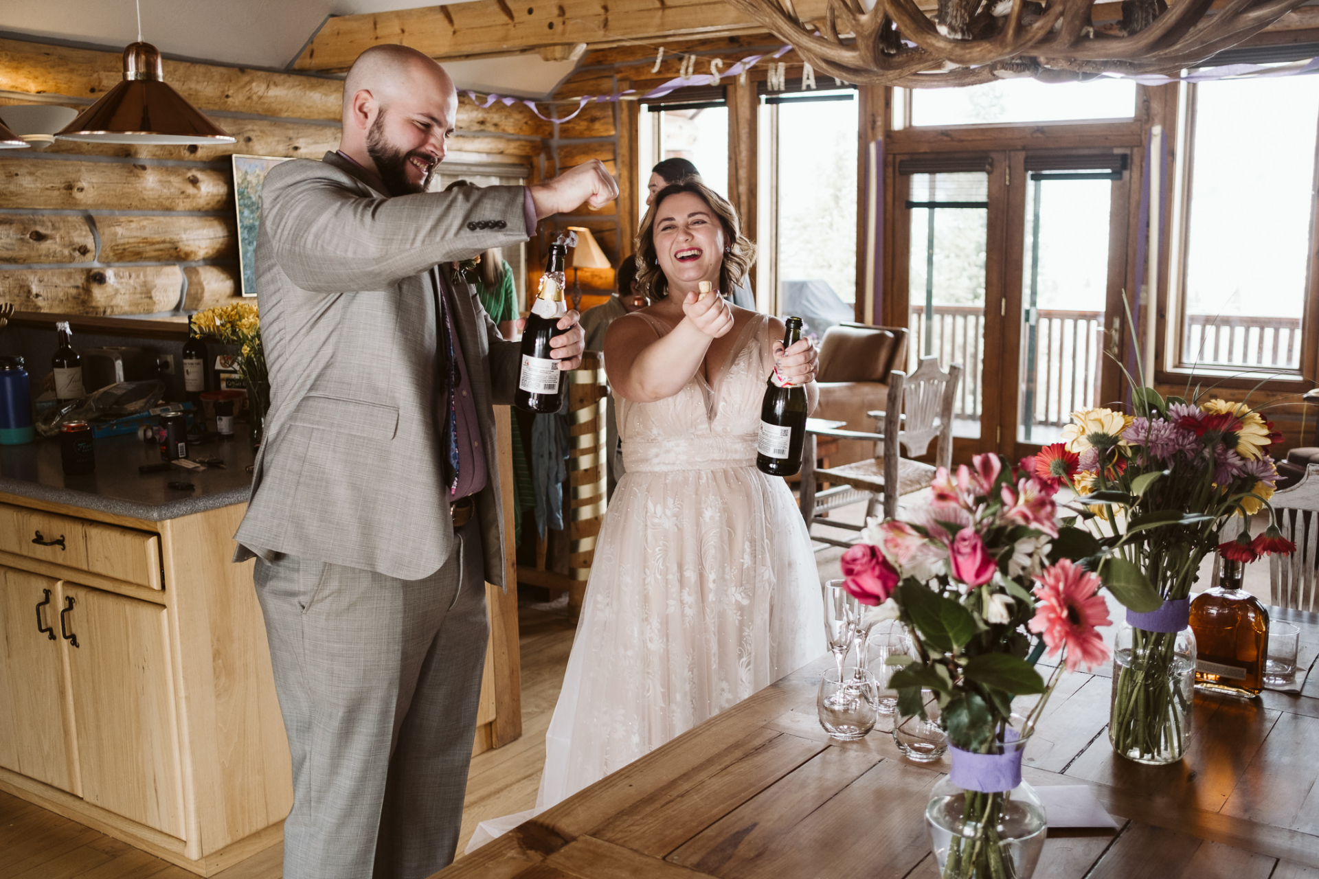 Crested Butte, CO Elopement Pictures | Bride and groom pop bottles of champagne for their guests