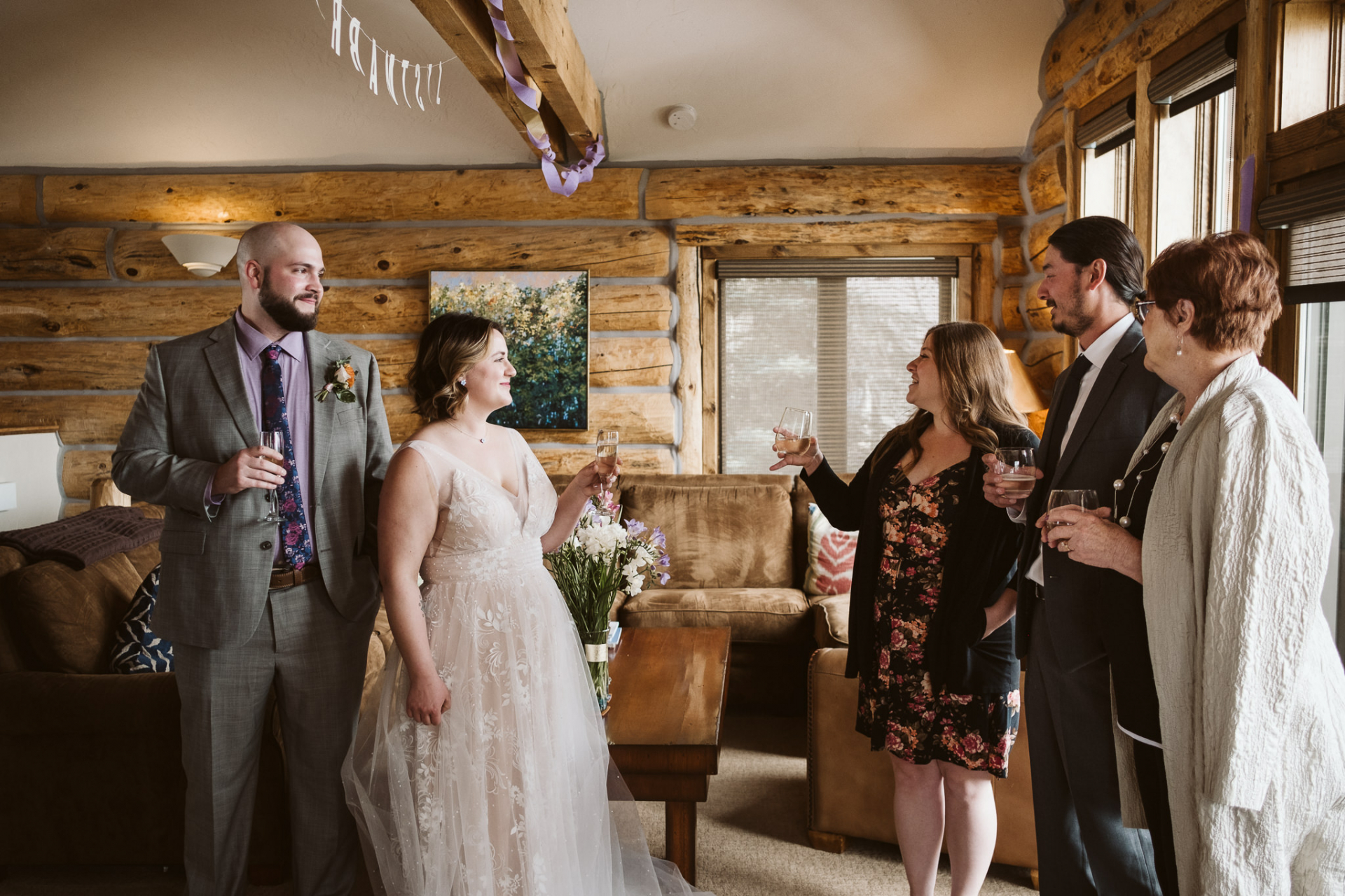 Crested Butte, Colorado Elopement Picture | Bride and groom's family gives toasts to the couple before heading outside into the snow for their ceremony