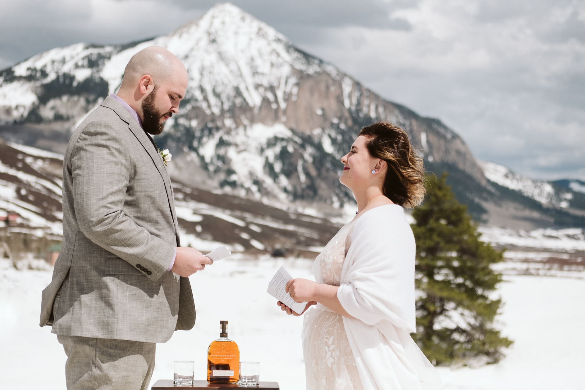 Colorado Elopement Ceremony Photo from Crested Butte | Bride and groom self-solemnize their elopement in Colorado, without an officiant - but with a good bottle of whiskey