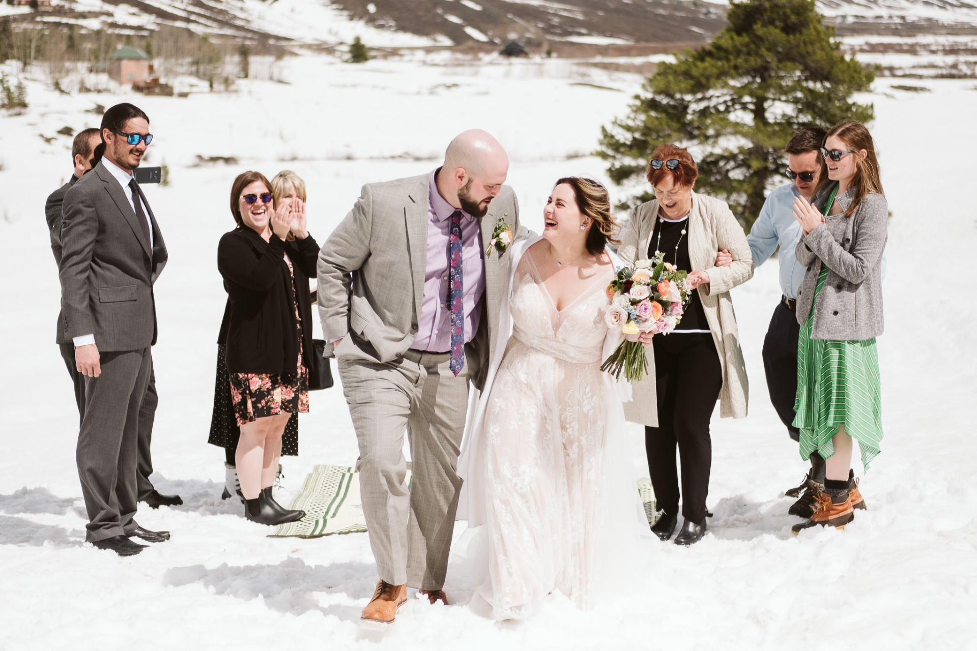 Colorado Winter Elopement Ceremony Photo | Couple walks back down the snow-covered aisle together after pronouncing themselves married