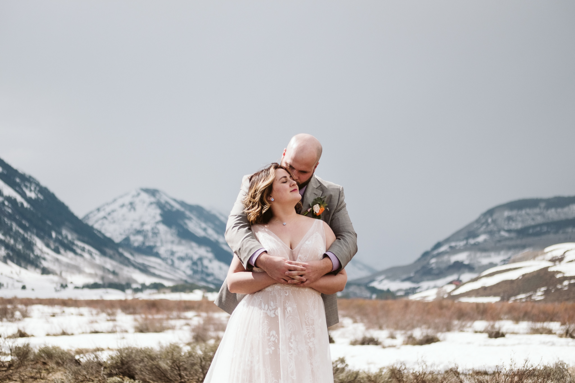 Colorado Winter Elopement Portrait | the most beautiful light for their portraits when the sun peeked through the clouds