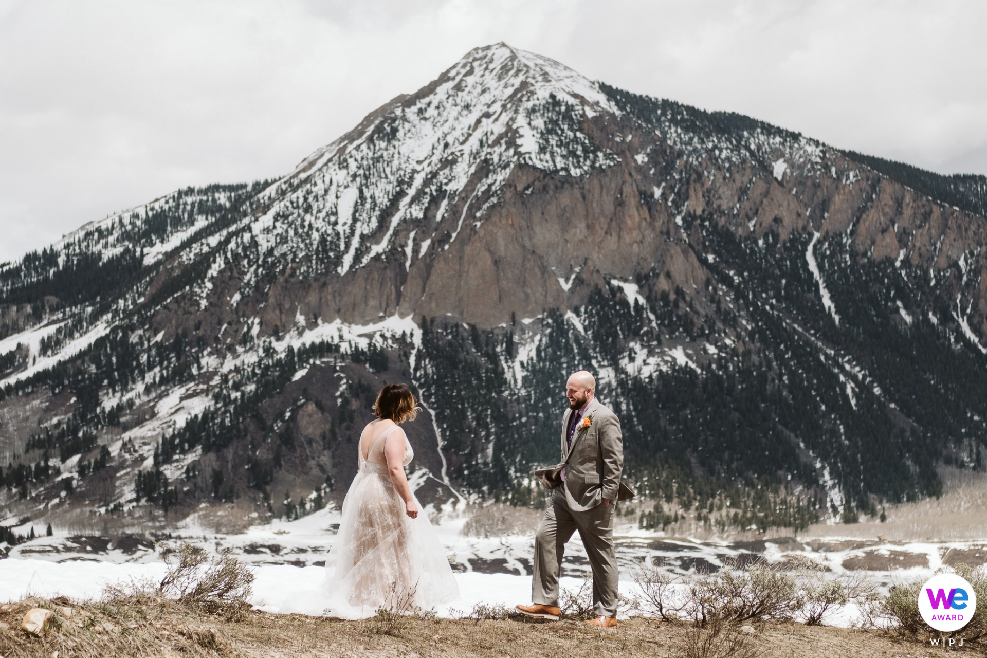 Crested Butte, CO Elopement Image | Bride and groom do a first look with mountain views