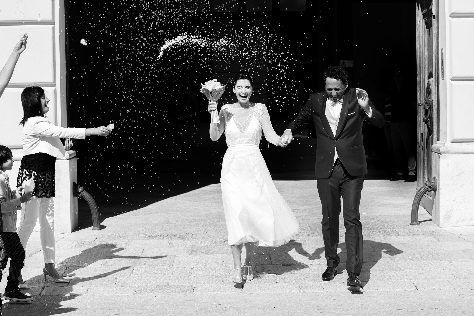 Trapani, Sicily, Italy Wedding Elopement Picture | It is always a joyful moment when the couple rejoices during the rice throwing