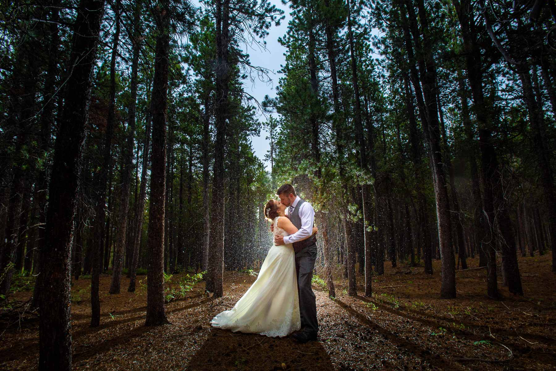Colorado Elopement Wedding Couple Portrait   It began to rain so we headed for the shade of the woods - but truly this didn't help at all as the tall pines didn't provide as much cover as we'd hoped