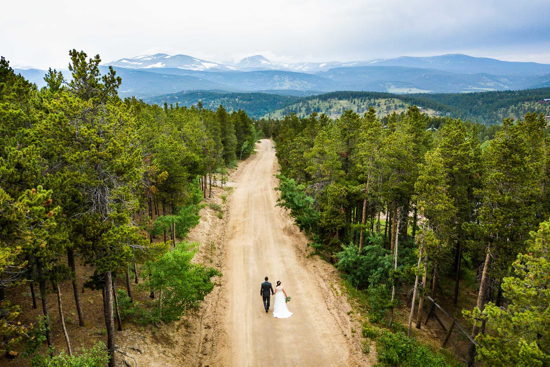 Colorado Wedding Couple Portrait   After finishing with photos, the couple walked back to their house along the road