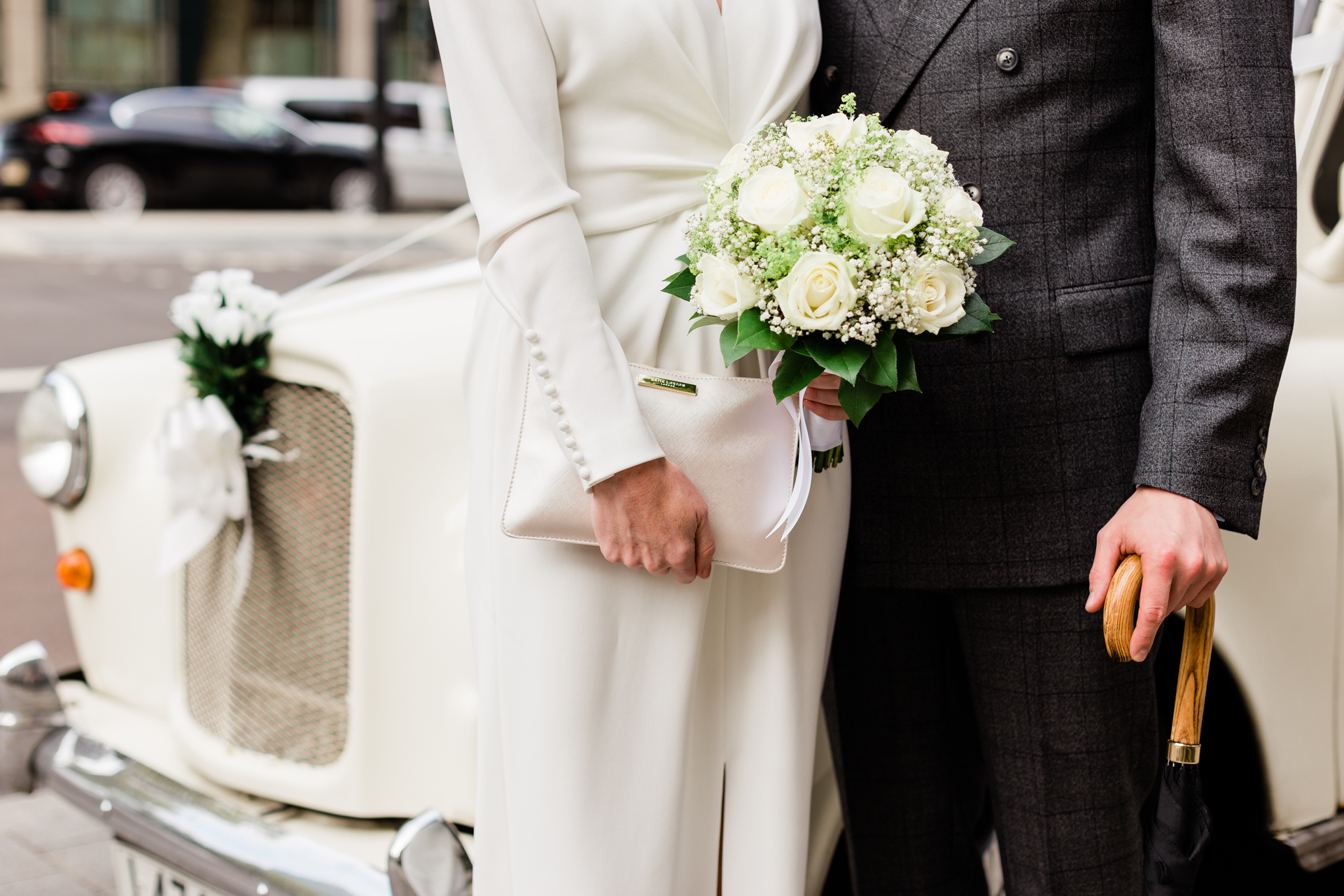 Central London Elopement Photography | The bride and groom arriving together with the focus on their details