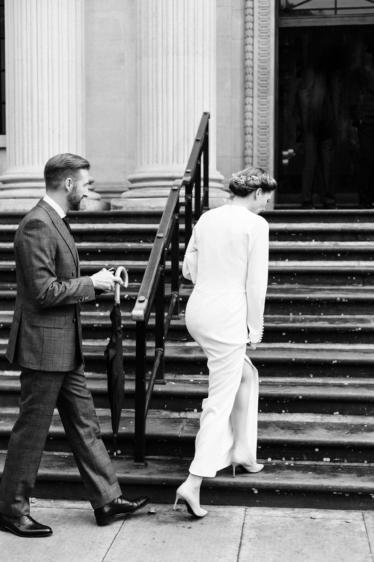 London Elopement Pictures | The bride and groom take the steps up to the doors of the town hall