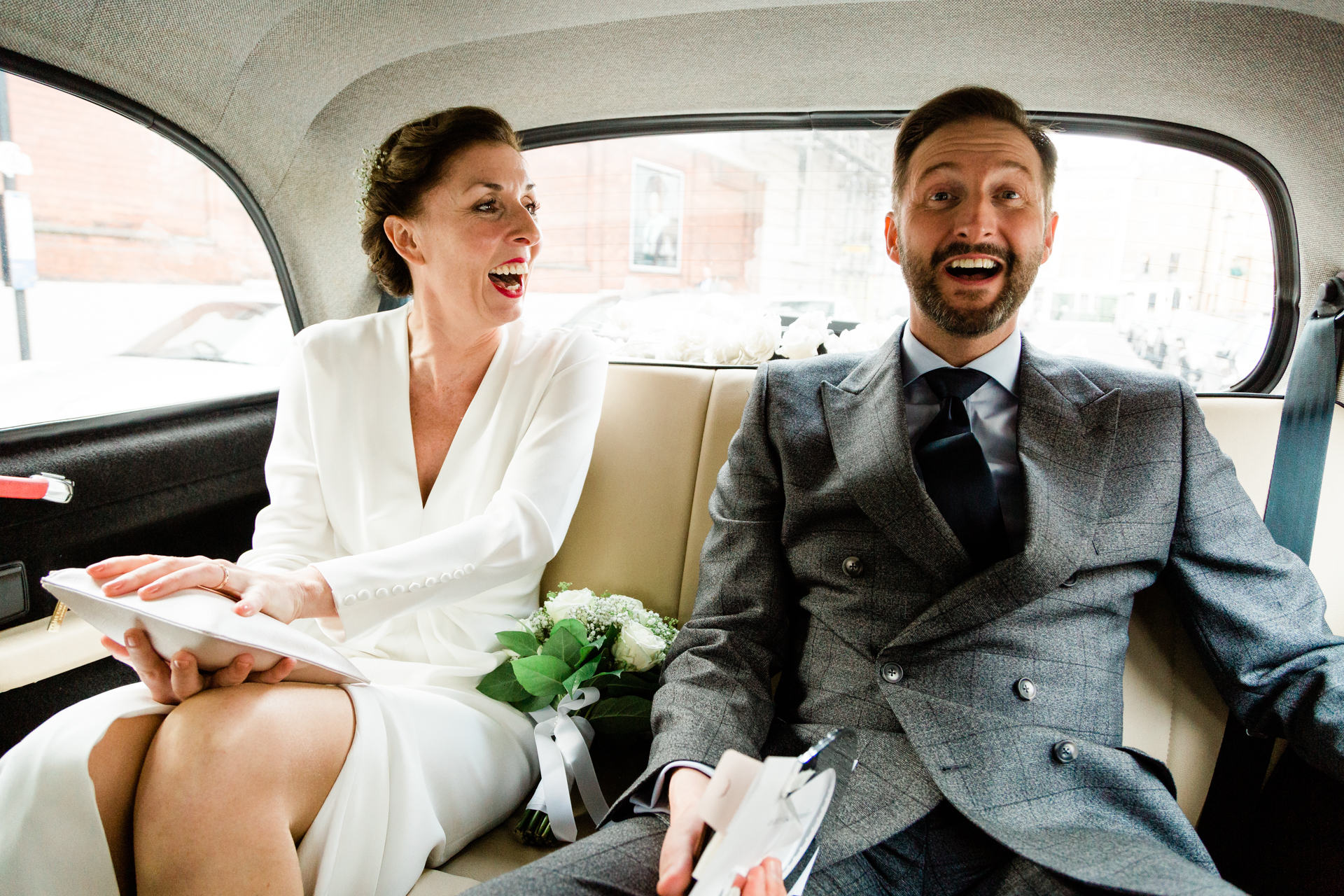 Central London Wedding Elopement Car Ride Image | Journeying with them to the reception venue, smiles and happiness all around now that they are officially married