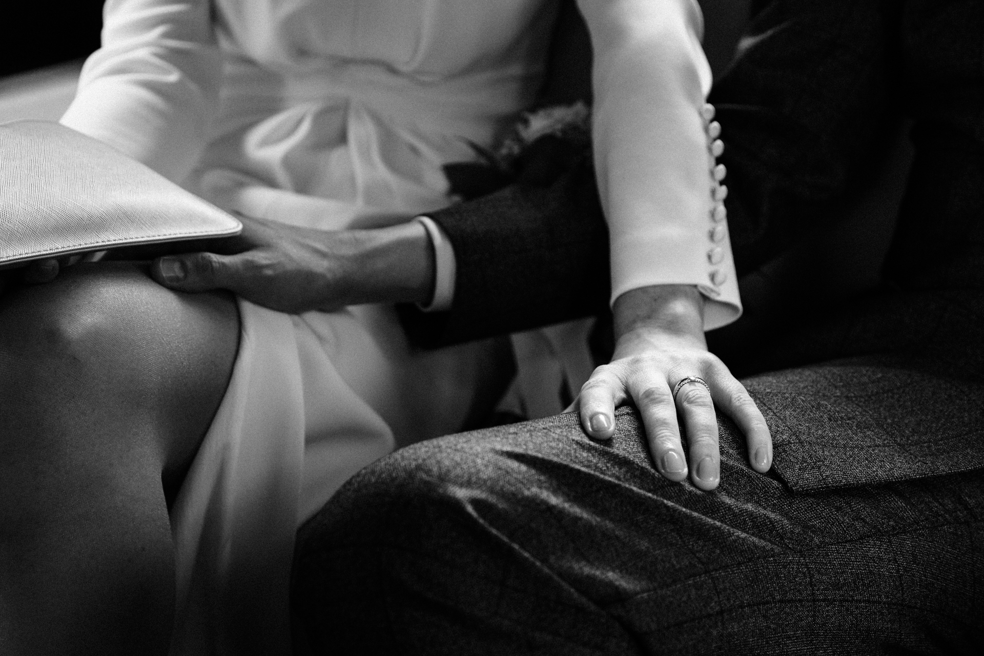 Central London Elopement Detail Image of Hands | In the taxi with them, laughter and jokes are shared, but the love and intimacy is still clear to see, with hands touching each others laps