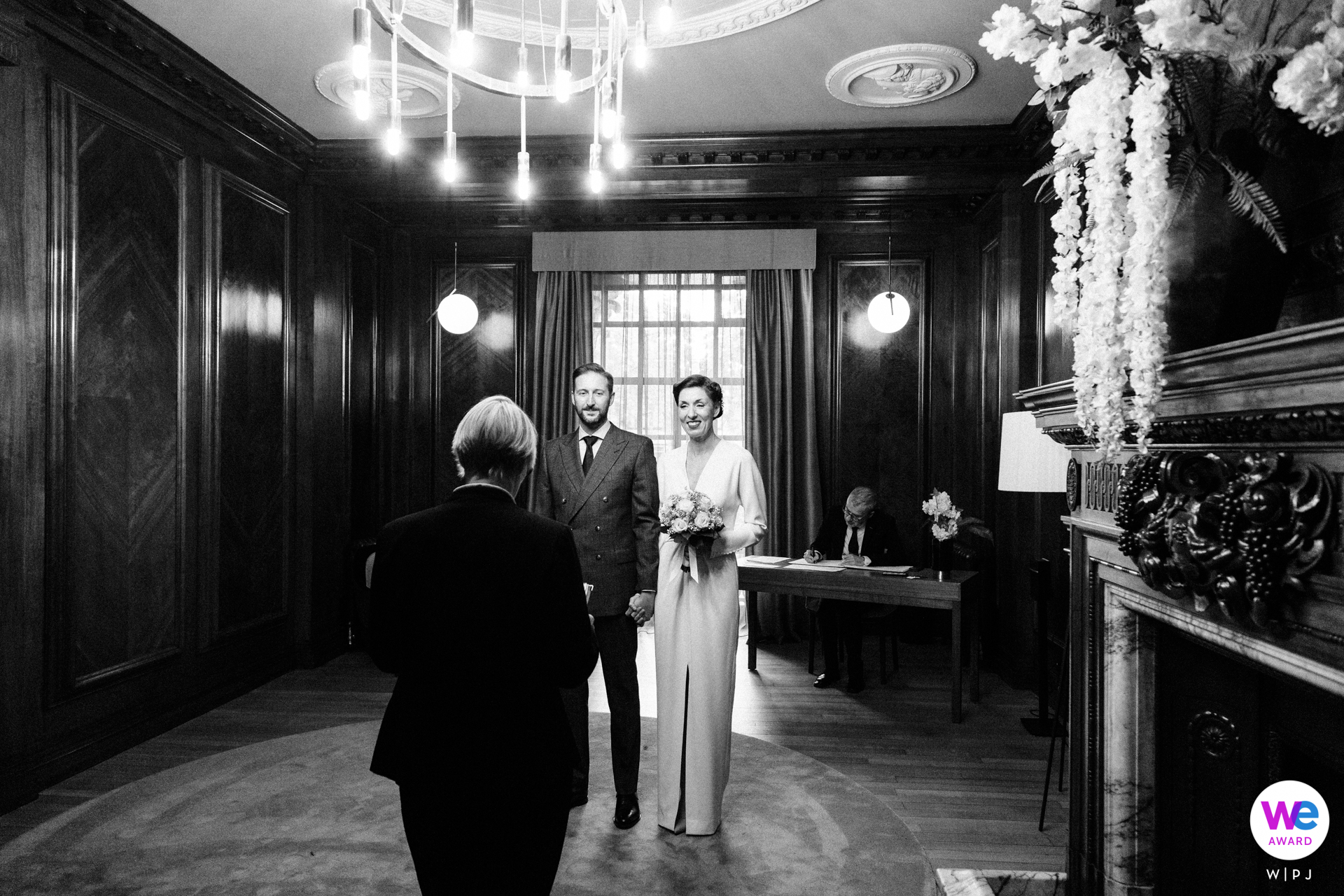 Central London Elopement Photographer | The bride and groom, during the ceremony at the Old Marylebone Town Hall in London