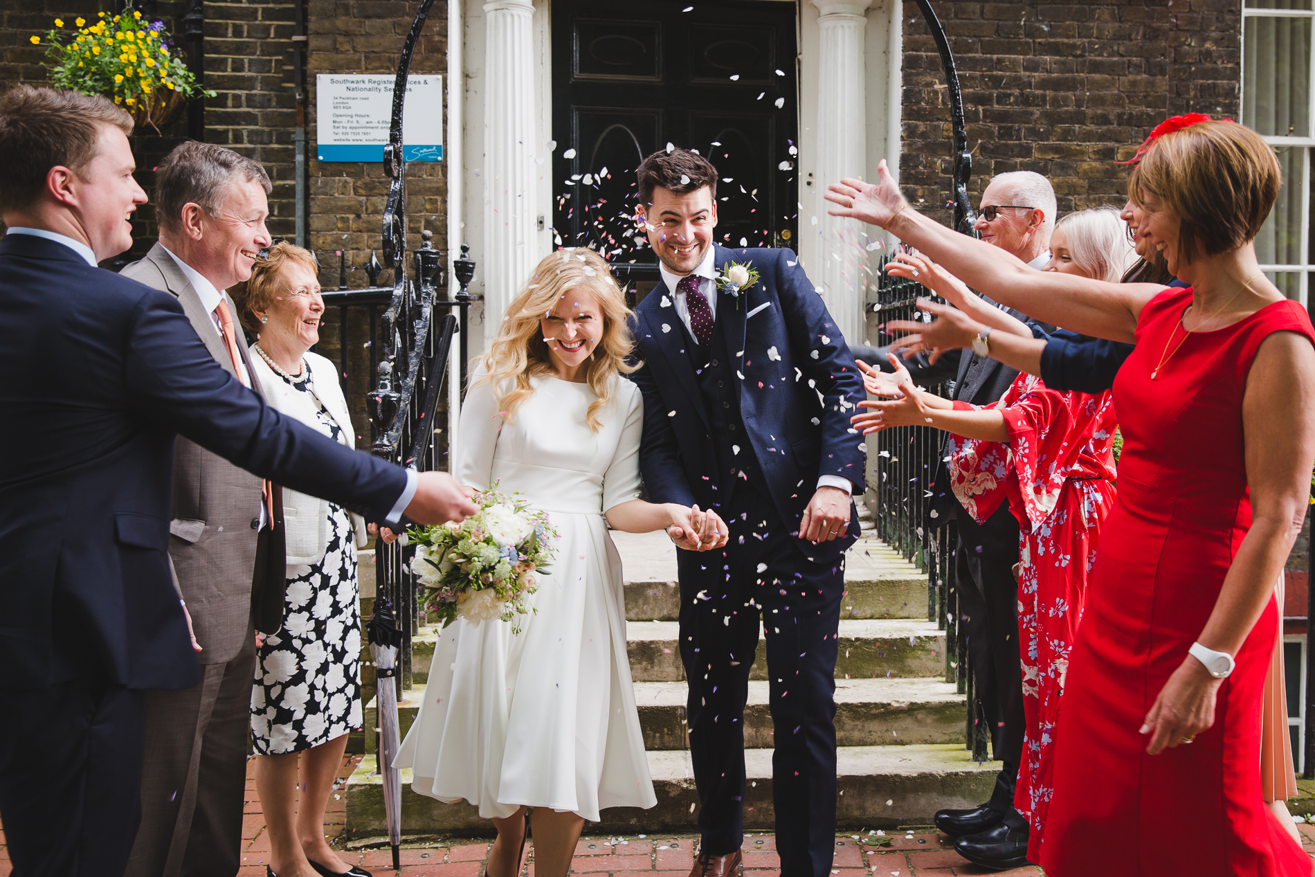 London Wedding Elopement Confetti Celebration Picture | friends and family shower them with confetti
