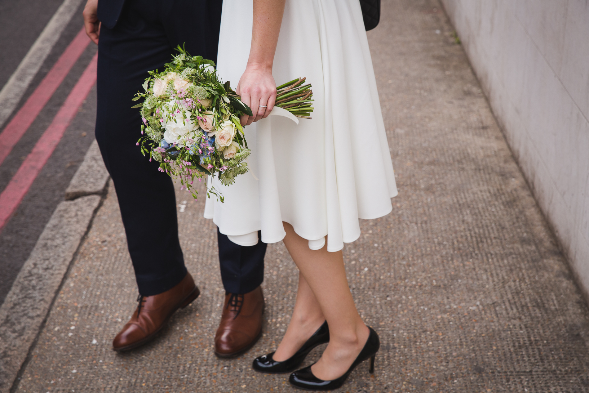 London Elopement Couple Urban Detail Picture | roses brought an air of spring to the couple's London ceremony