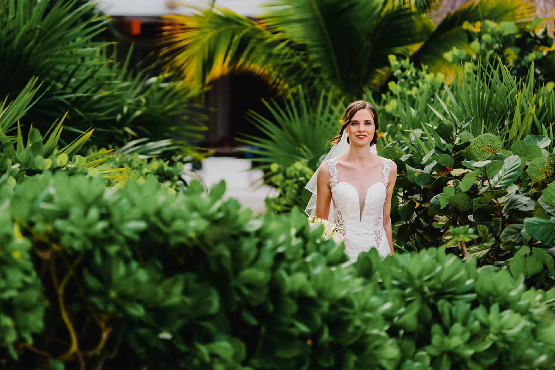 Excellence Playa Mujeres, Cancun Mexico Elopement Bride Image | the bride strolls through the vibrant foliage