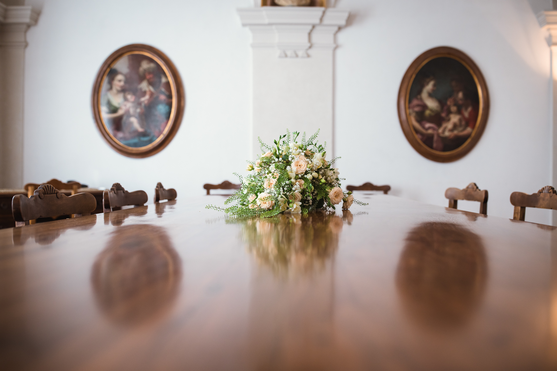 Switzerland Wedding Detail Image | a hint of spring to the city hall's interior, nicely accentuating the room's rich hardwoods