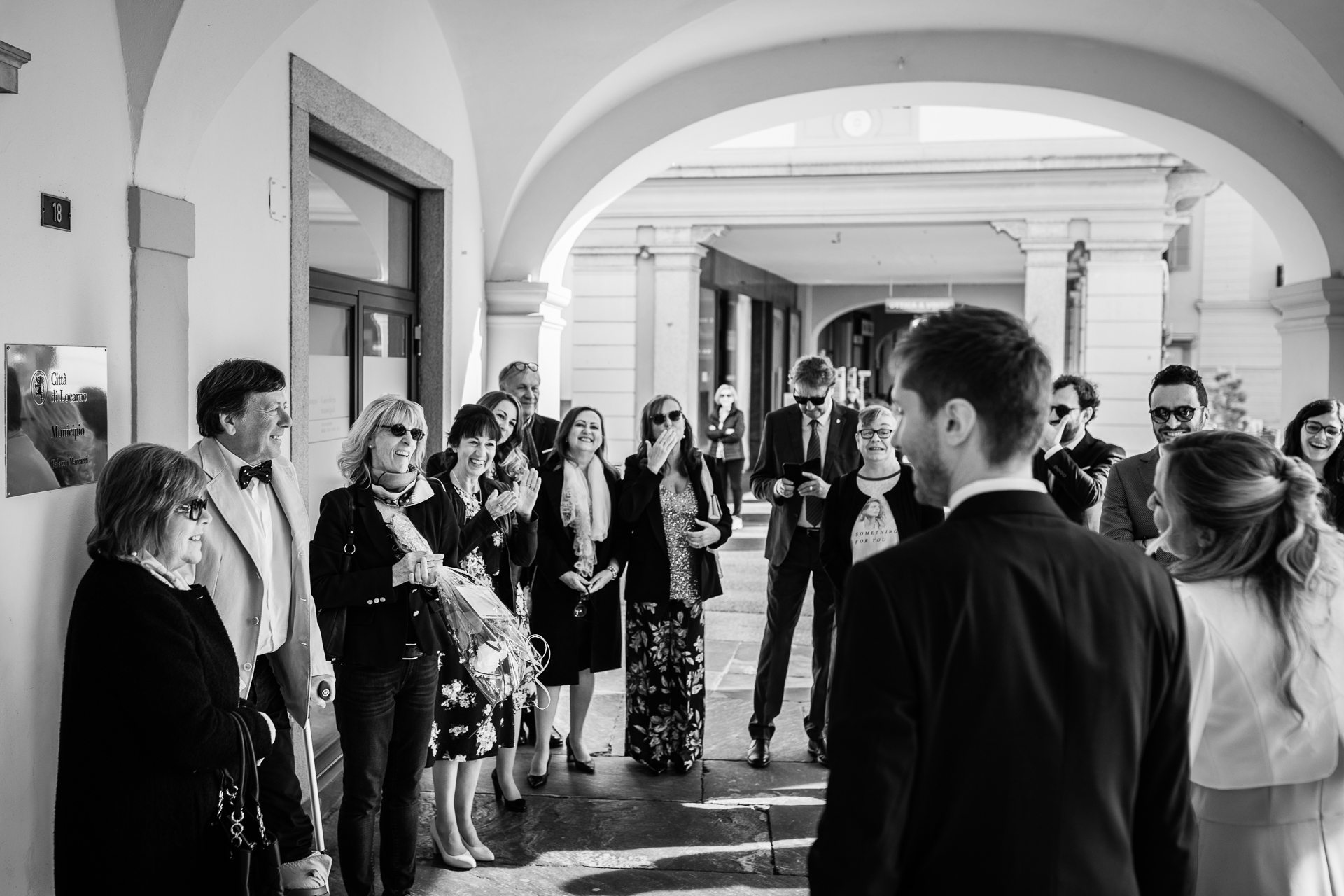 Locarno Switzerland Elopement Ceremony Photographer | A crowd of family and friends greets the smiling couple