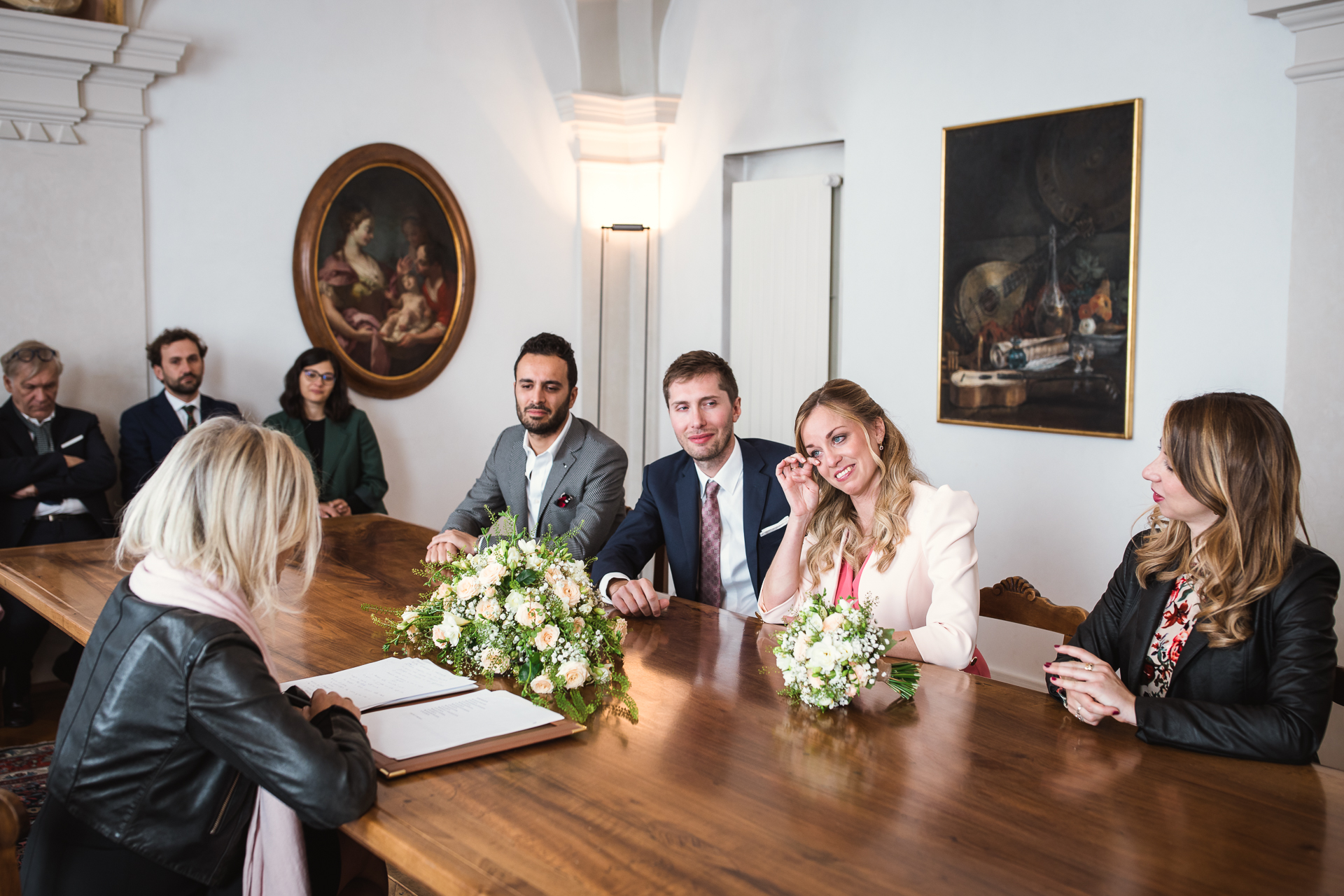 Switzerland City Hall Civil Wedding Ceremony Picture | the couple's councilor conducts their wedding ceremony, surrounded by loved ones in the intimate setting