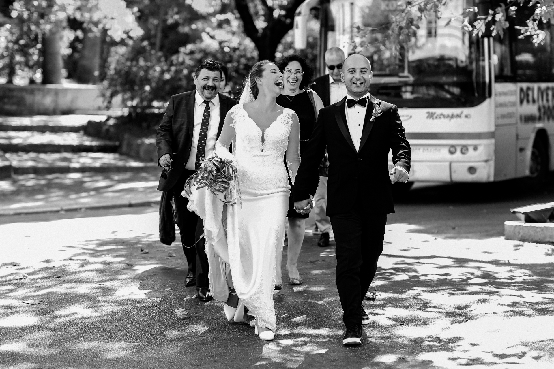 Greece Wedding Elopement Picture | The bride, groom and their family walk to the Turkish Consulate for their wedding ceremony