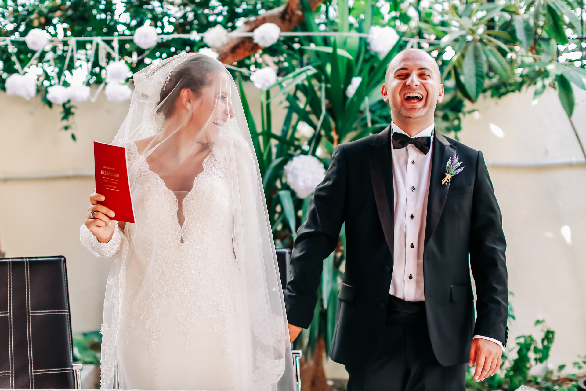 Greece Elopement Ceremony Picture | The bride smiles at the groom from behind her veil