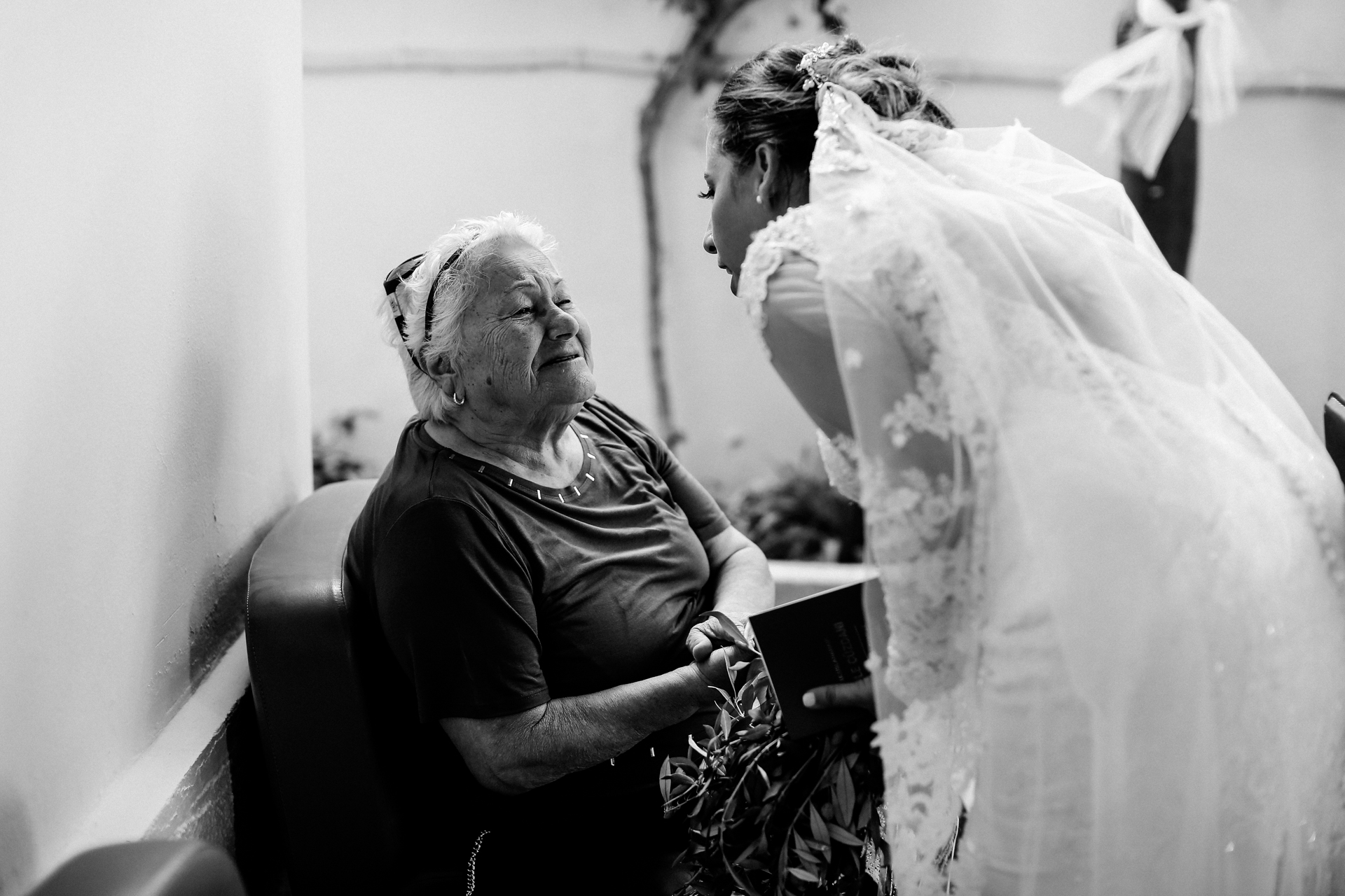 Greece Wedding Photographer, Image of the Bride | the bride shares a warm moment with her grandmother