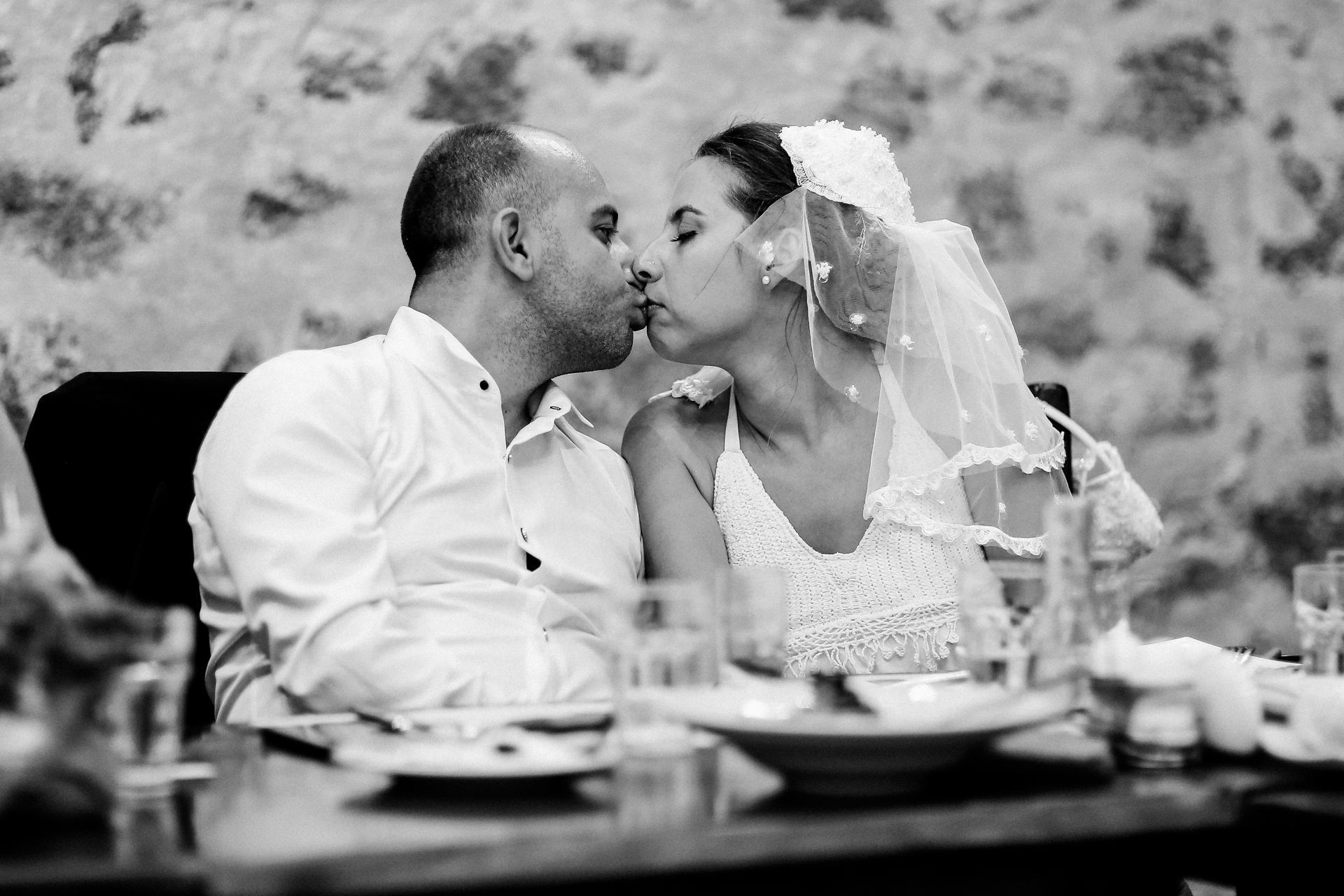 Greece Wedding Photo from the Reception Dinner Party |  the couple share a quiet moment as they sit down to a dinner reception