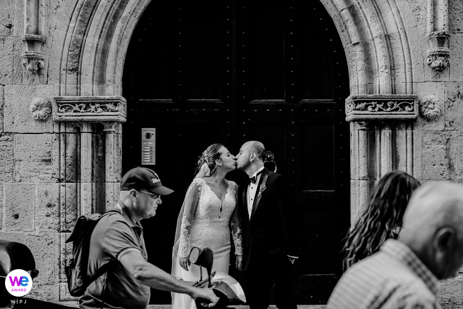 Rhodes, Greece Elopement Photo Story | Newlyweds steal a kiss on the bustling streets of Rhodes in Greece