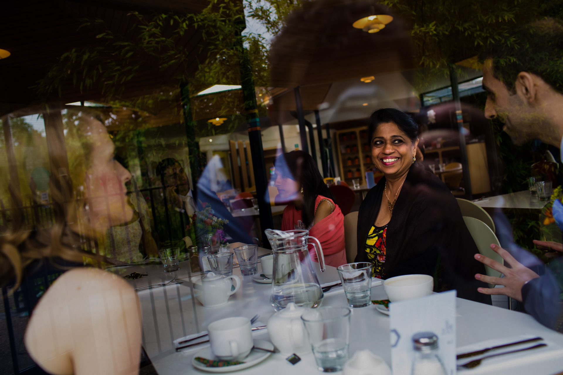 London Wedding Reception Image from Regents Park | The family shares warm smiles and animated conversation