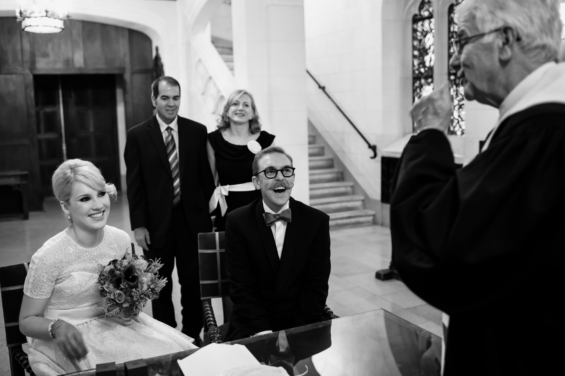 Paris, France Elopement Ceremony Photos | The couple's attendant breaks the mood with a story