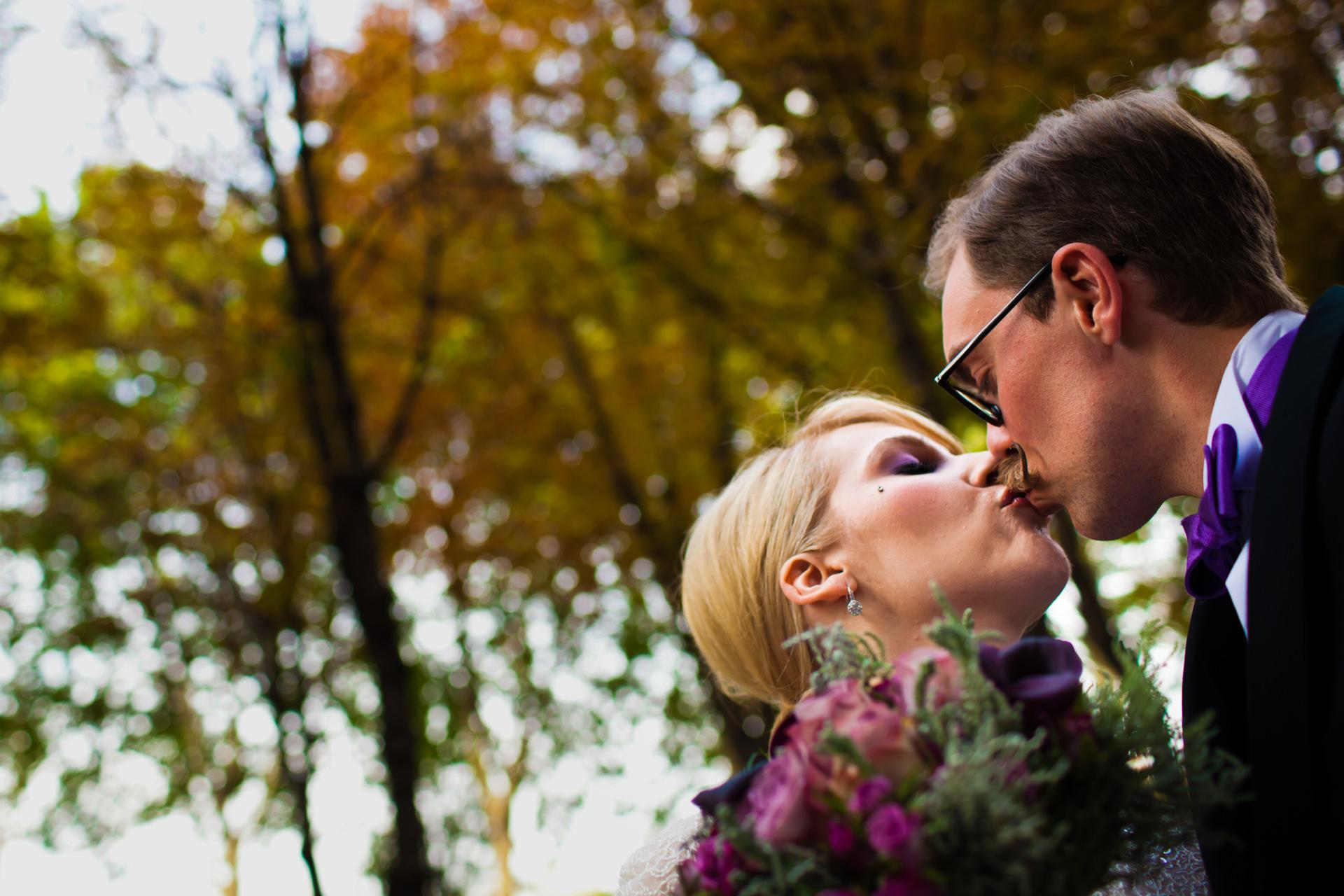Paris, France Wedding Couple Portrait | a kiss in a verdant corner of Paris after signing their wedding registry