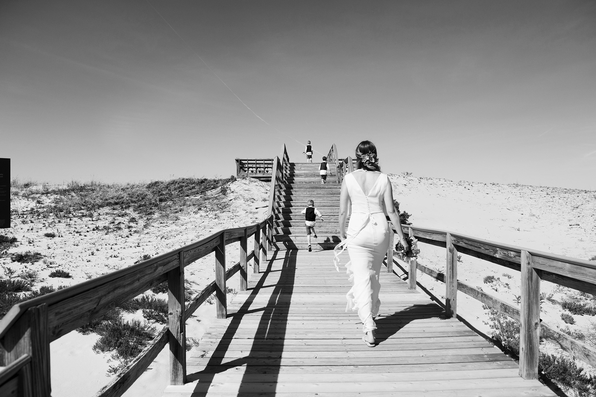 Ipswich, Massachusetts Elopement Photography   The bride and her sons heading to the beach for the ceremony