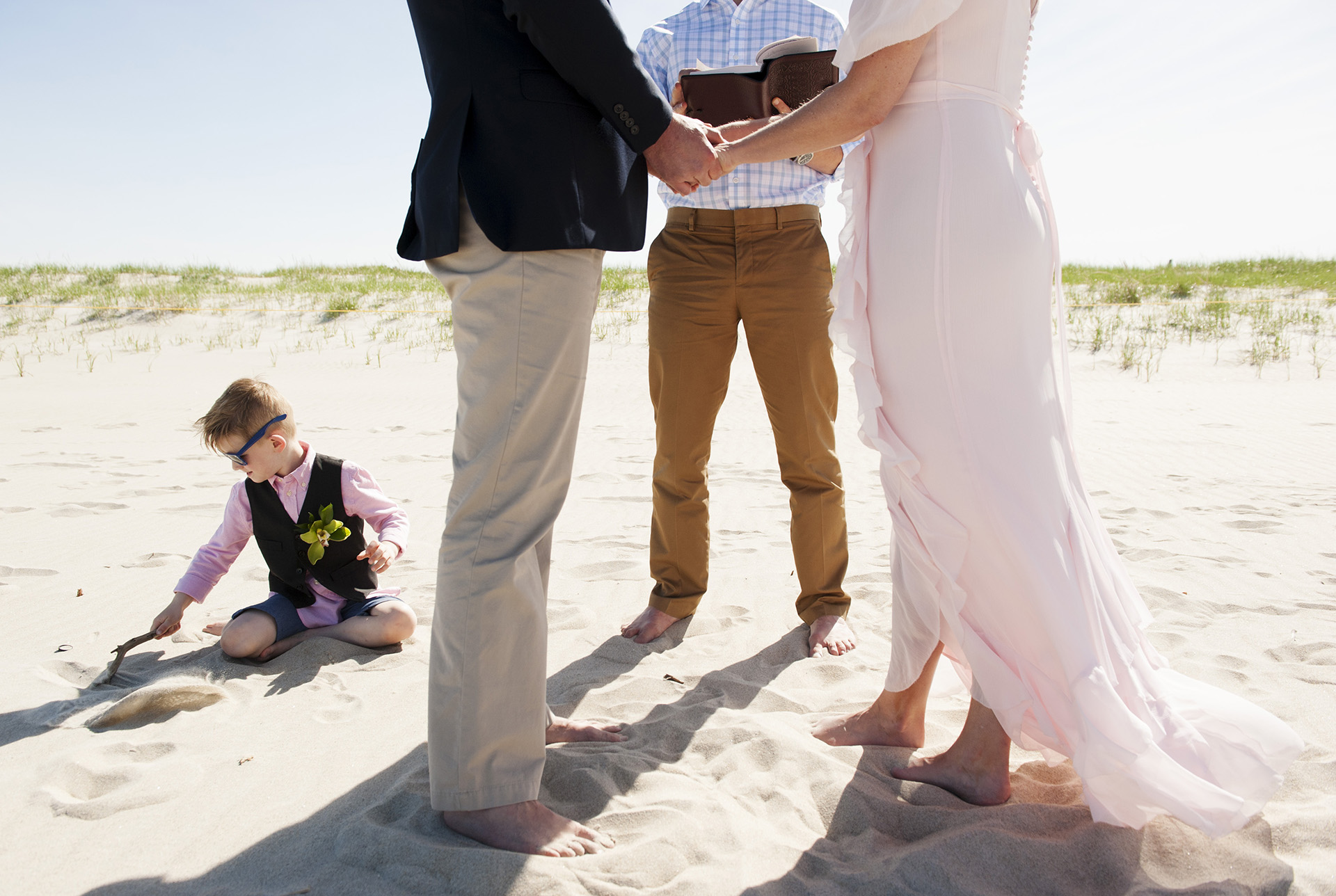 Ipswich, MA Beach Wedding Ceremony Pictures   The ceremony, with the bride's youngest son playing in the sand