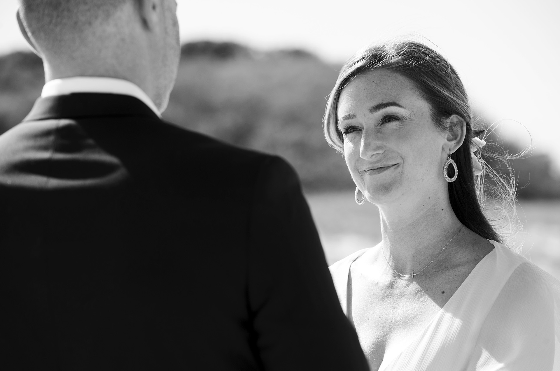 MA Beach Elopement Wedding Ceremony Photo   The bride smiling at the groom during ceremony