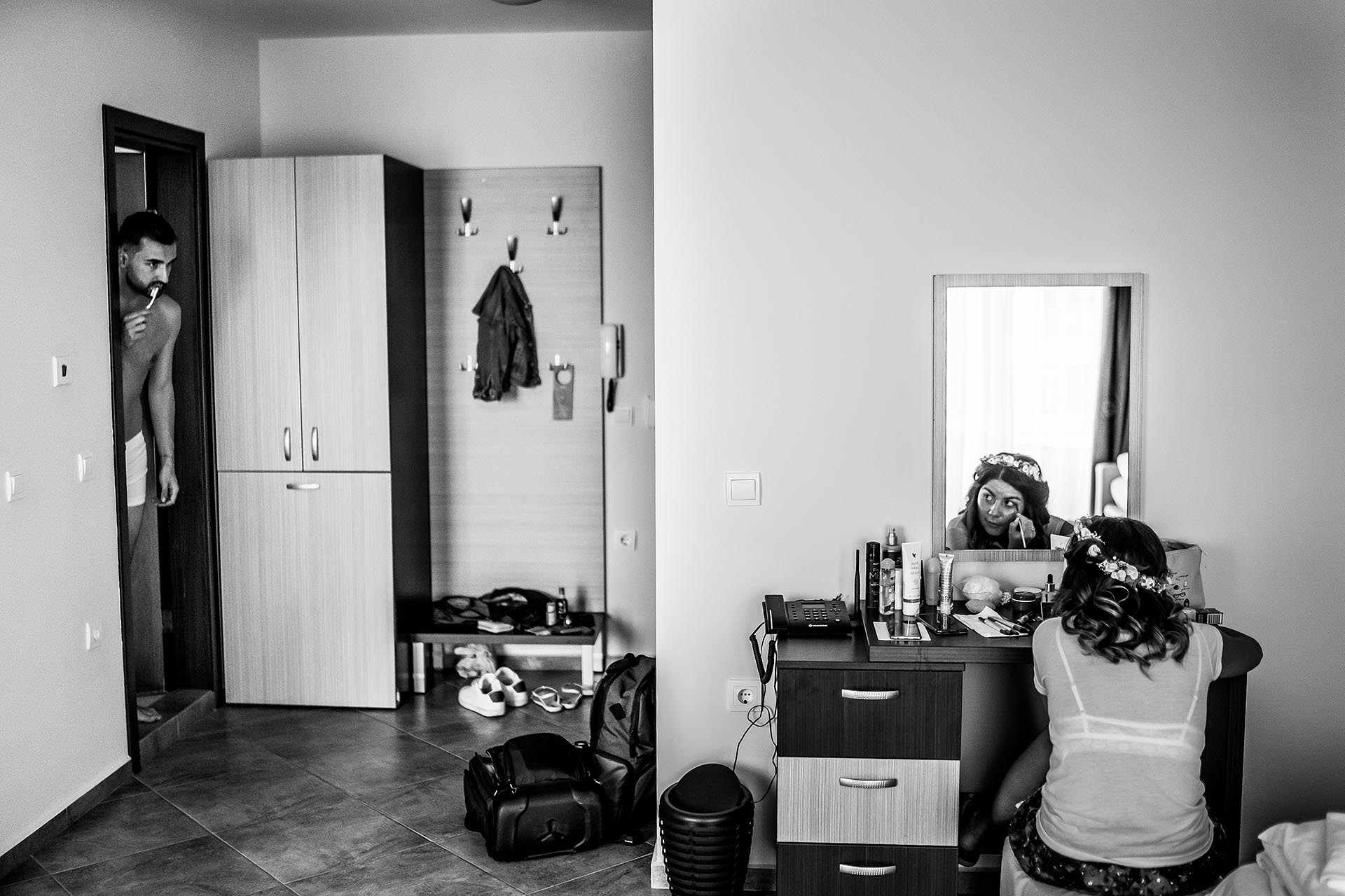 Smokinya Beach, Sozopol, Bulgaria Elopement Photographer | The groom peaks out of the bathroom while brushing his teeth
