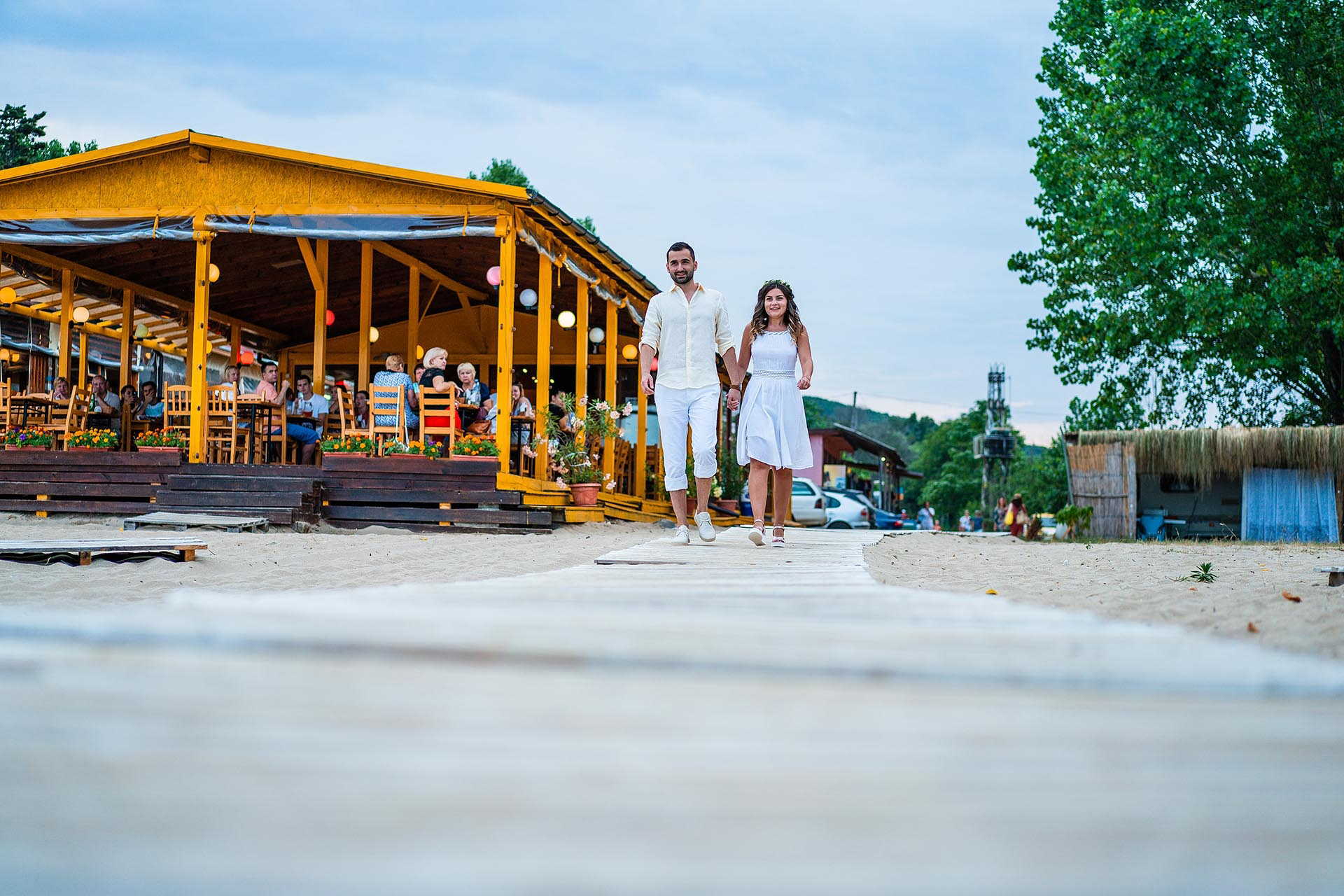 Sozopol, Bulgaria Beach Elopement Ceremony Picture | the couple walk side-by-side down the aisle