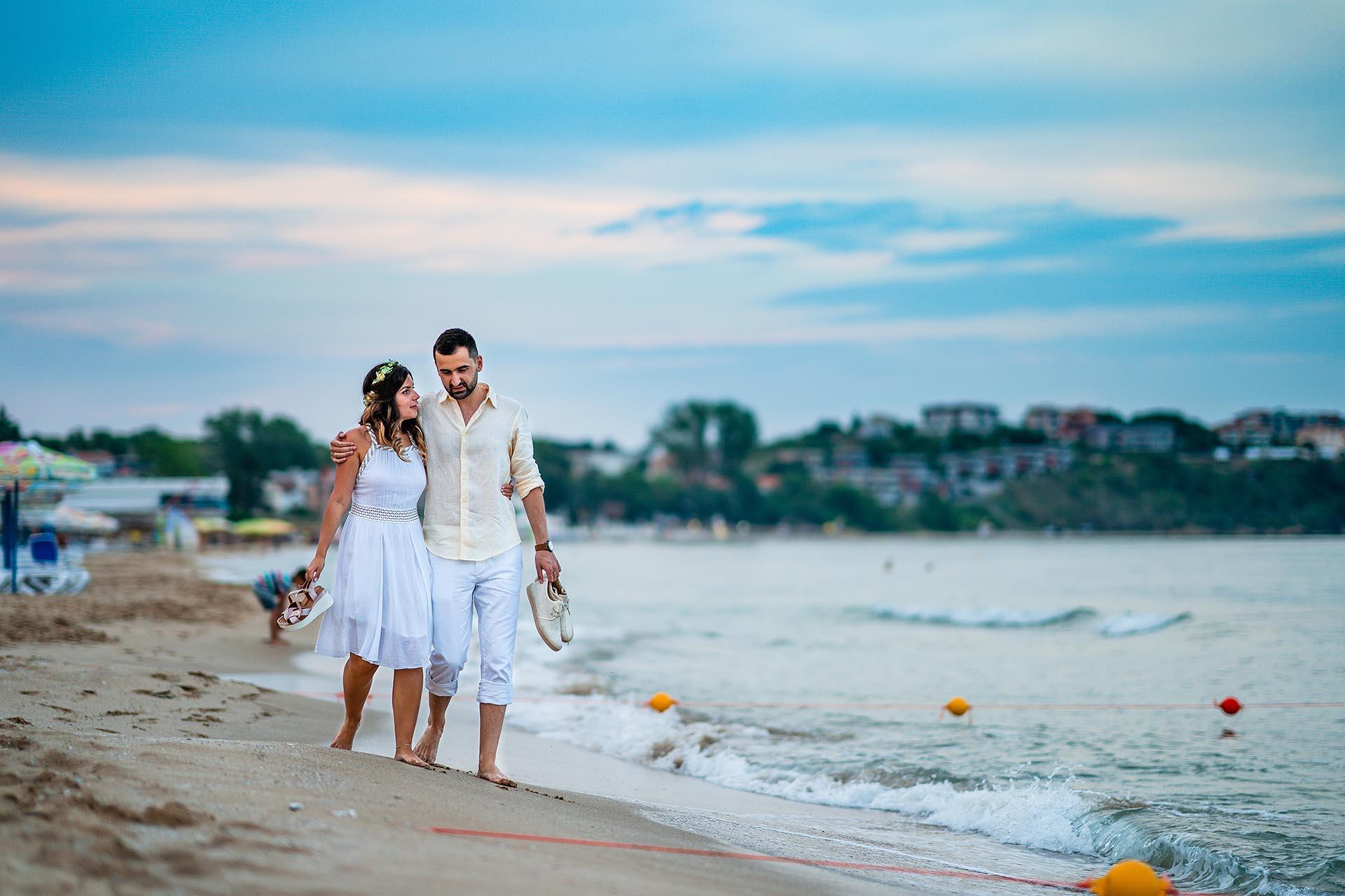 Bulgaria Beach Wedding Portrait | The bride and groom stroll down the beach