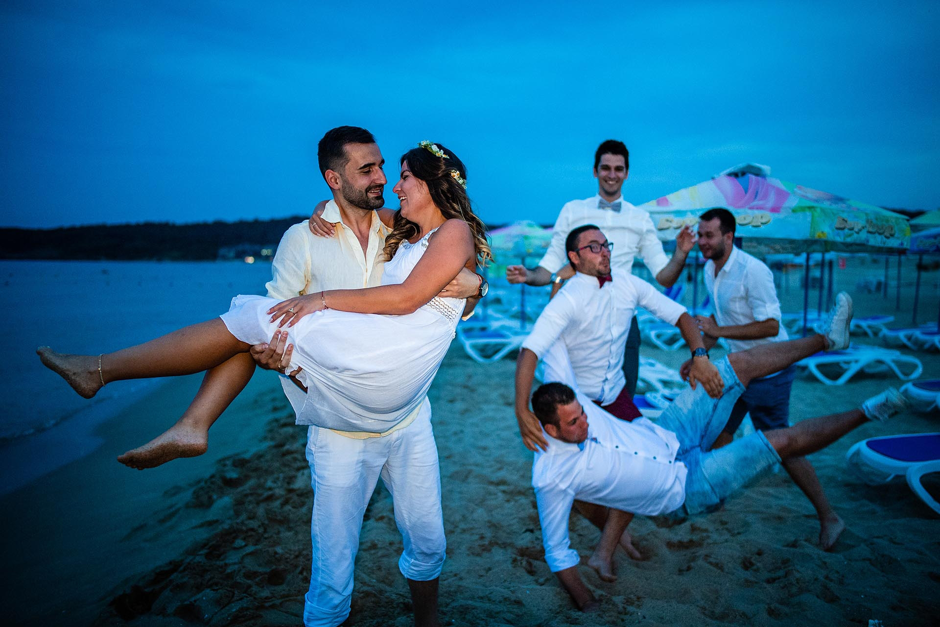 Bulgaria Elopement Wedding Image | The groom sweeps the bride off of her bare feet