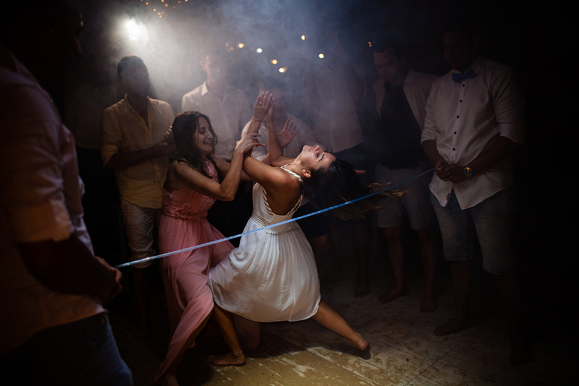 Bulgaria Beach Wedding Party Photo | The bride makes short work of the limbo pole