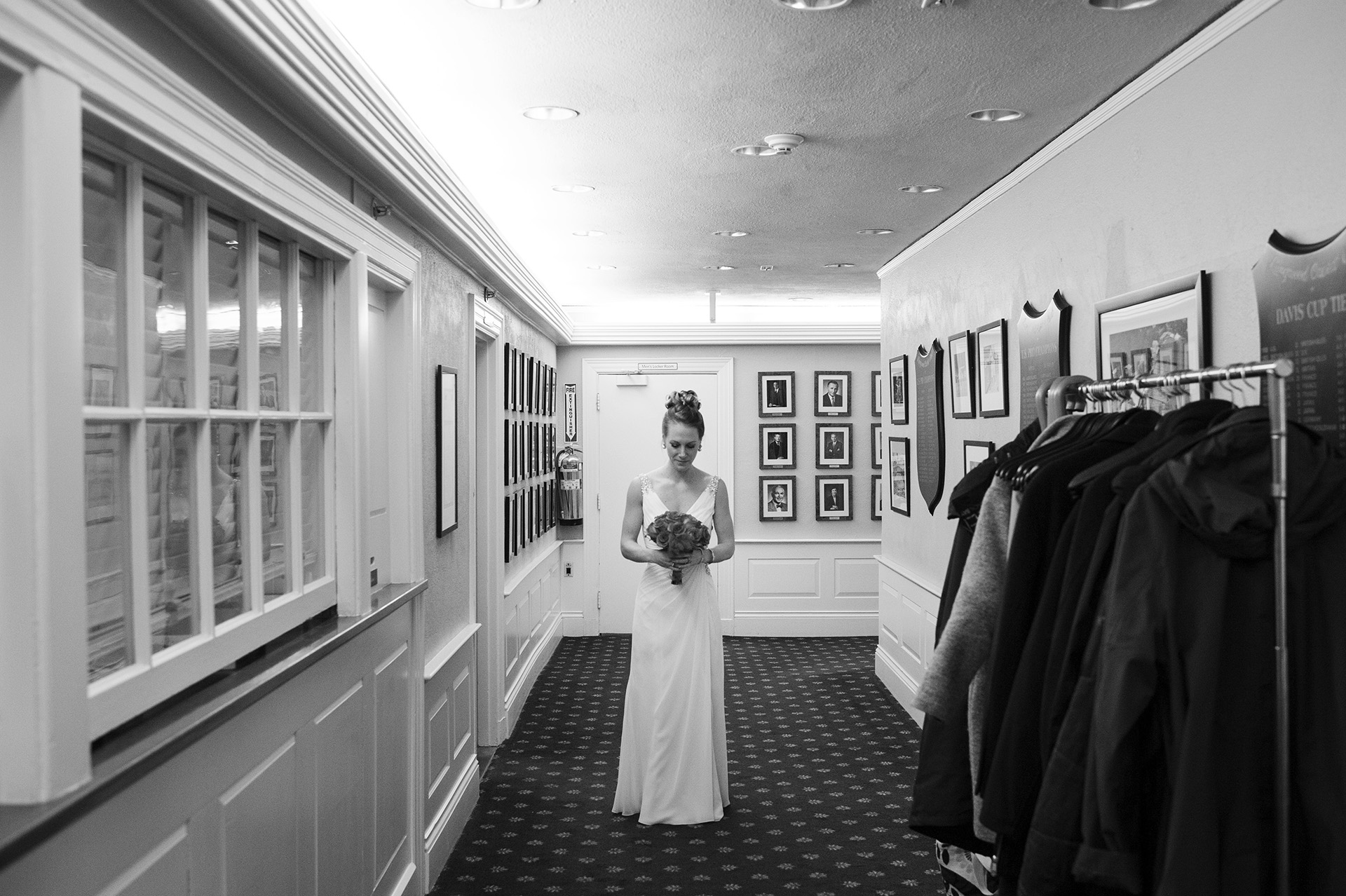 Chestnut Hill, MA Elopement Bride Image | The bride takes a quiet moment to herself in the hallway