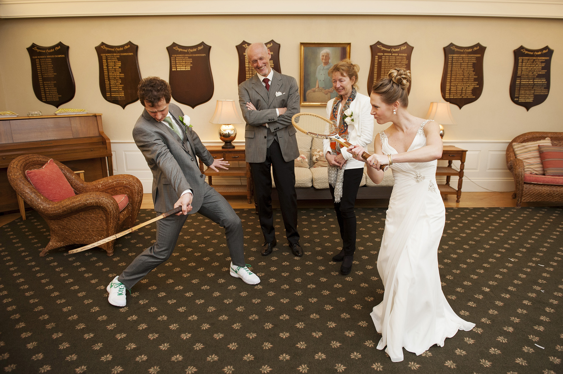 Chestnut Hill, Massachusetts Elopement Picture | The bride and groom show off their tennis skills