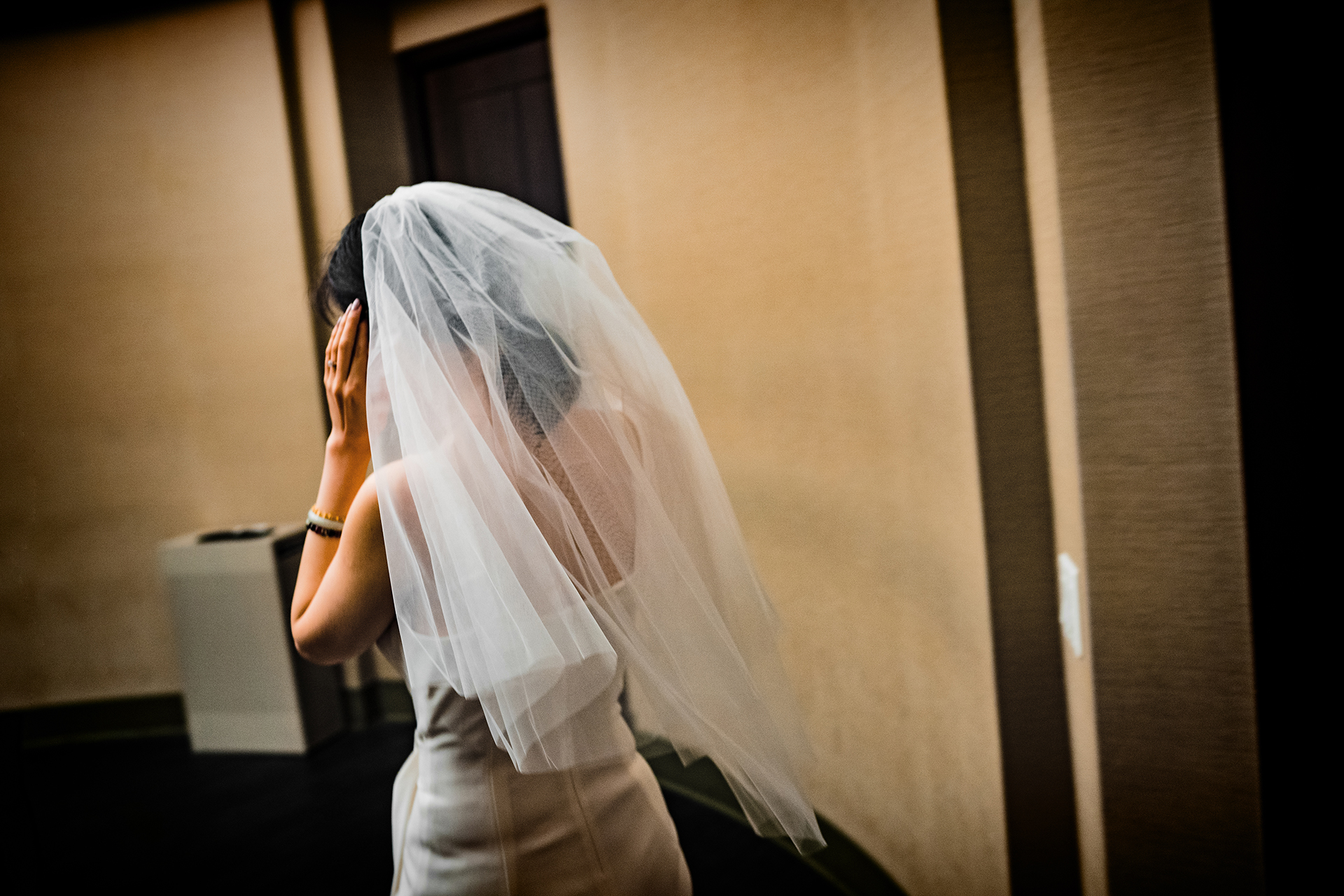 City Clerk at New York City - Bride Elopement Photo | The bride walks into the ceremony chambers