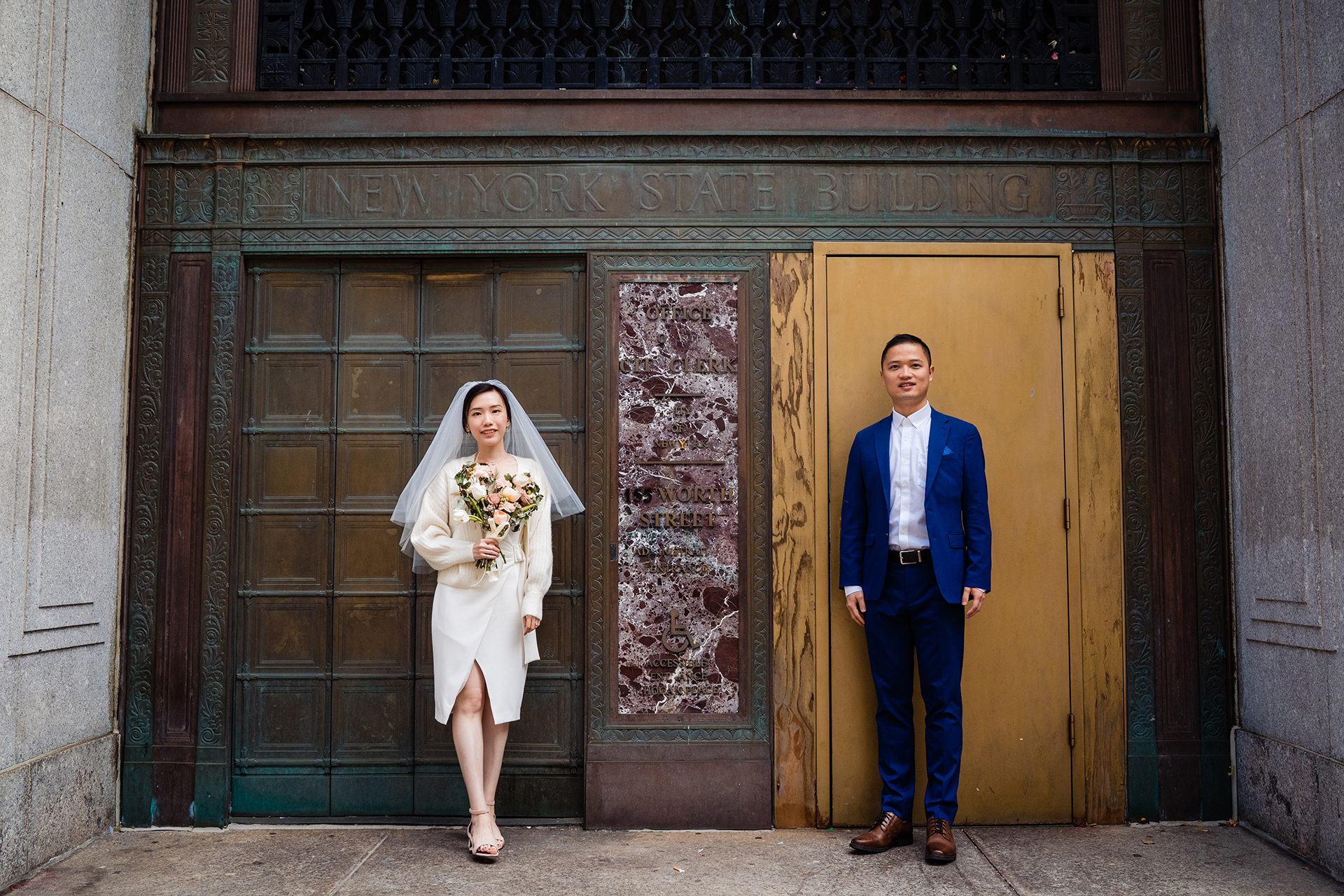 NYC - City Clerk Elopement Couple Portrait | The vibrant whites and blues of the young couple's wedding colors