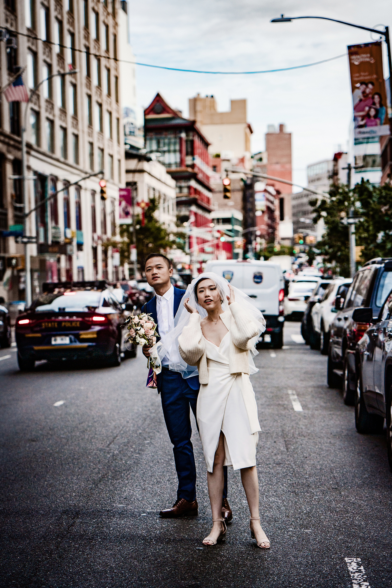 NYC Wedding Elopement Couple - Urban Street Image | The bride and groom are rushing off into the busy New York streets