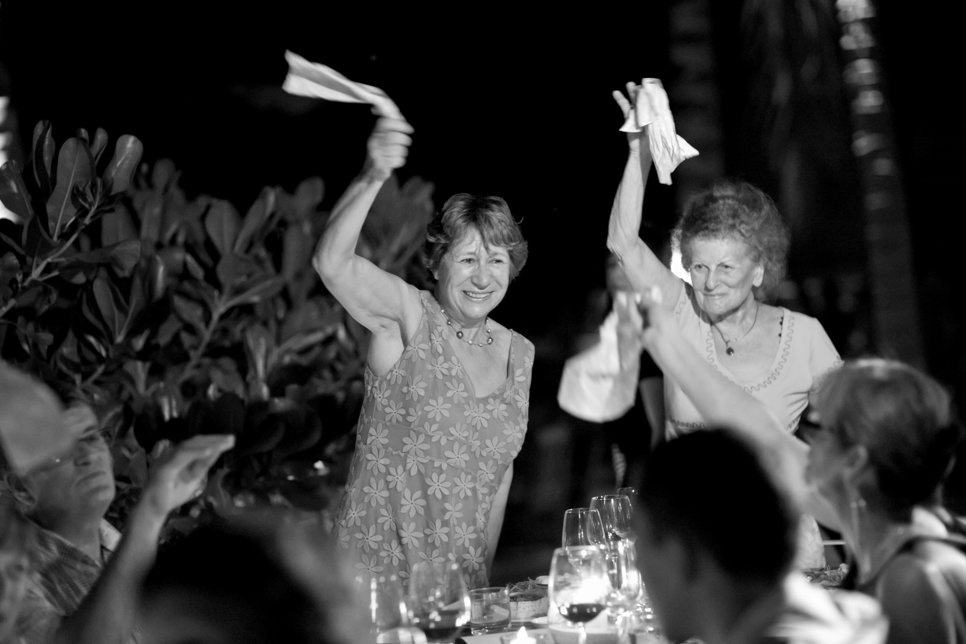 Batu Batu Island, Malaysia Wedding Photography | Guests raise glasses and twirl their napkins