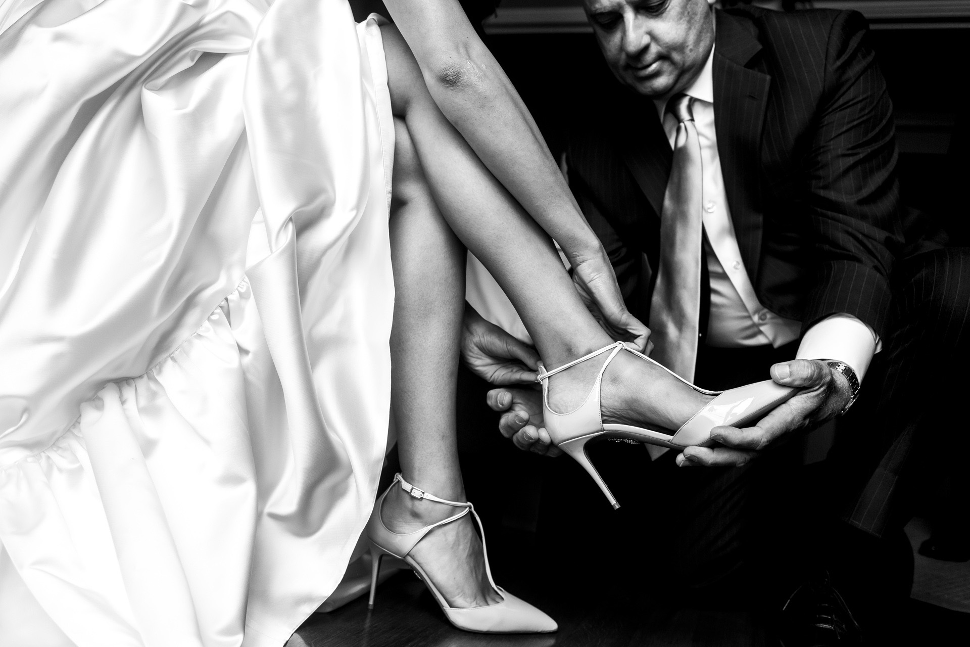 Istanbul, Turkey Wedding Elopement Bride Detail Photo | The bride's father is helping her with her wedding shoes