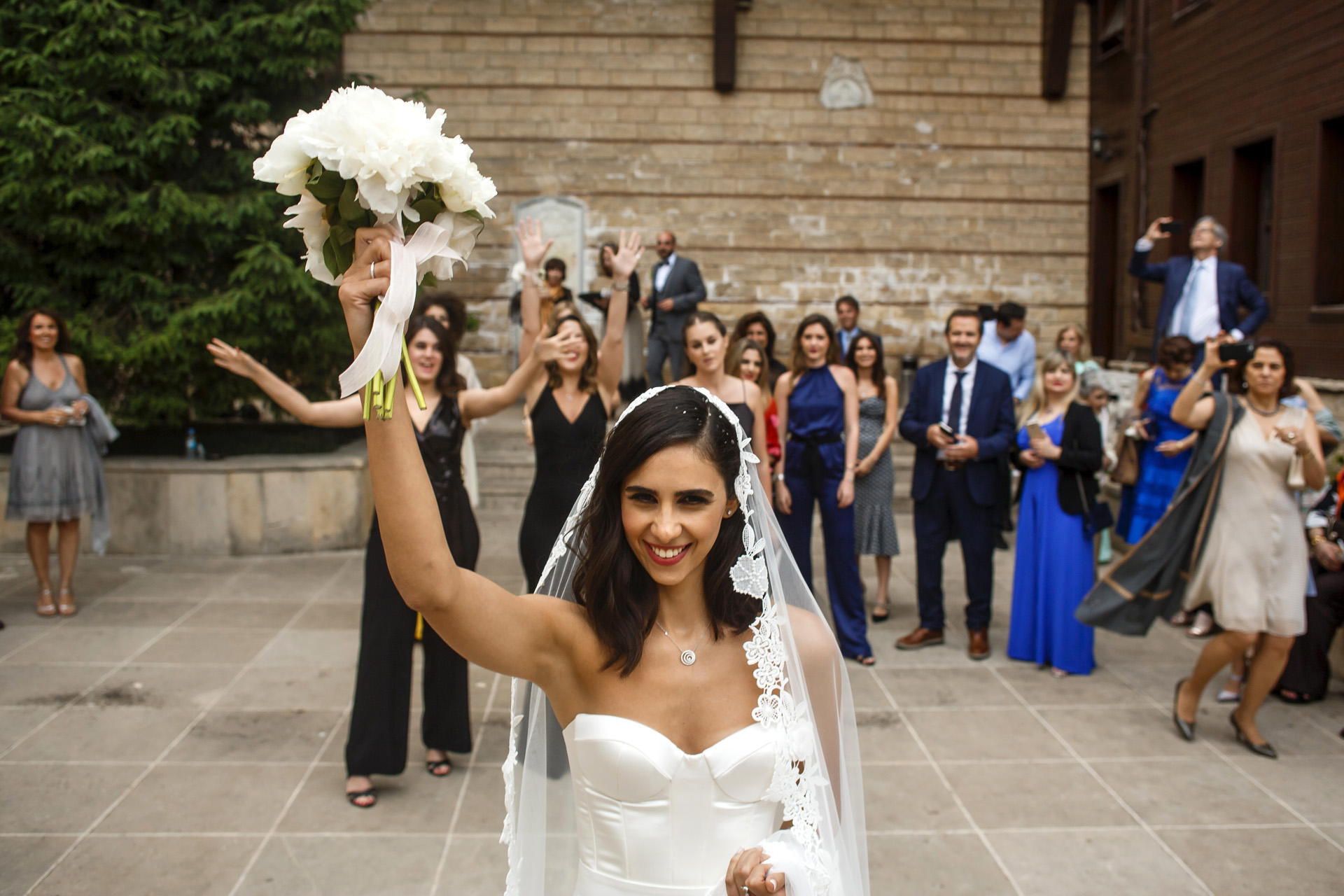 Balat, Istanbul, Turkey Wedding Photography | The bride is throwing the bouquet