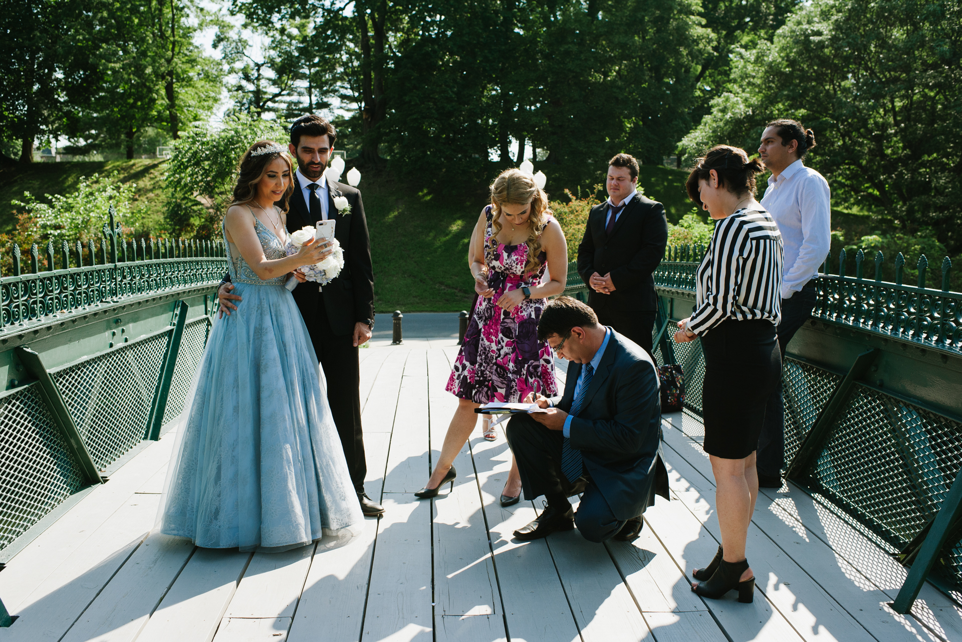 New York Elopement Ceremony Photography | The bride and groom stand with friends