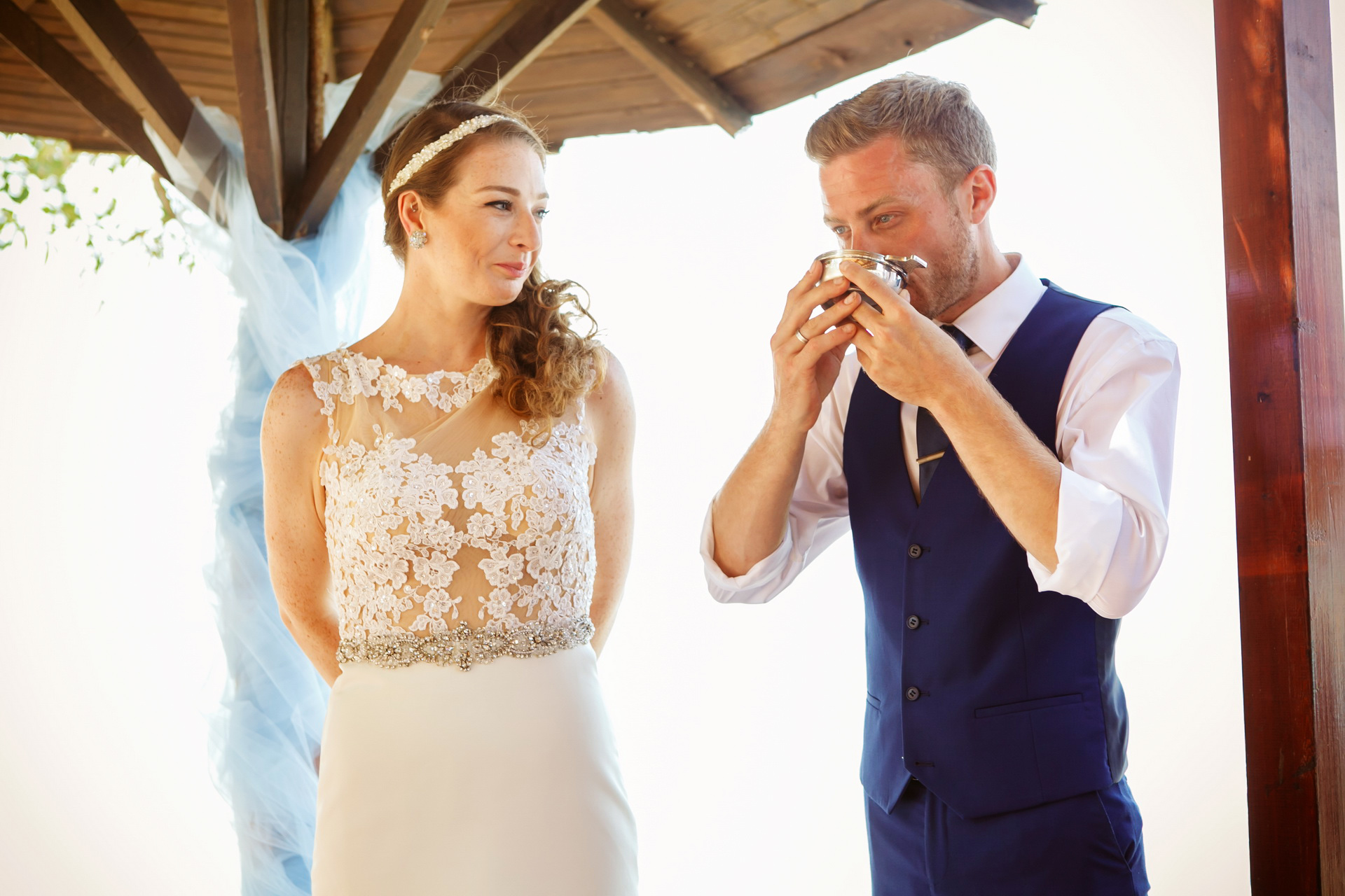Boukari - Corfu - Ionian Islands, Greece Elopement Ceremony Image | The couple share a glass of wine