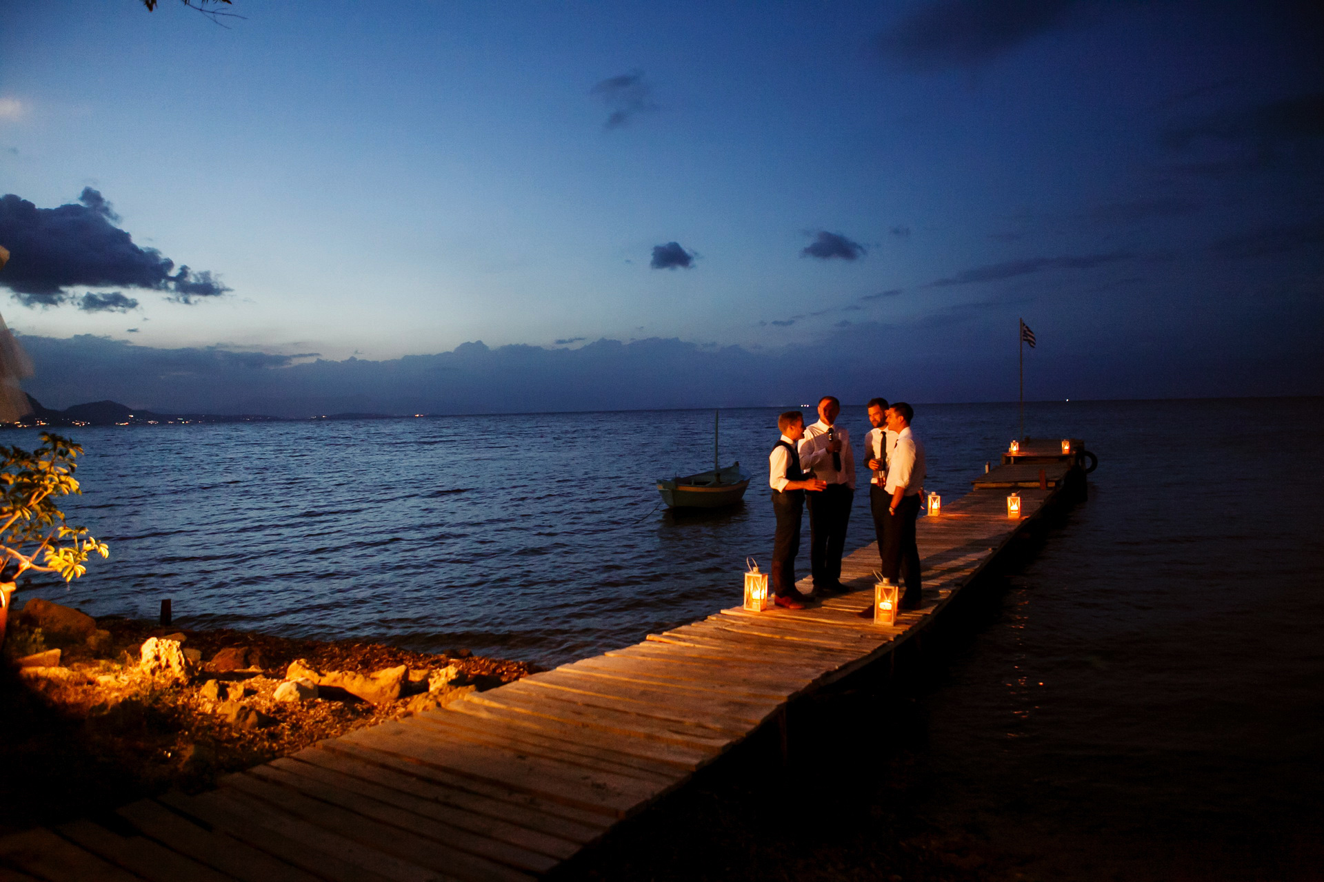 Greece Beach Wedding Elopement - Dusk Photography | moonlight provide the perfect setting for conversation among friends at the water