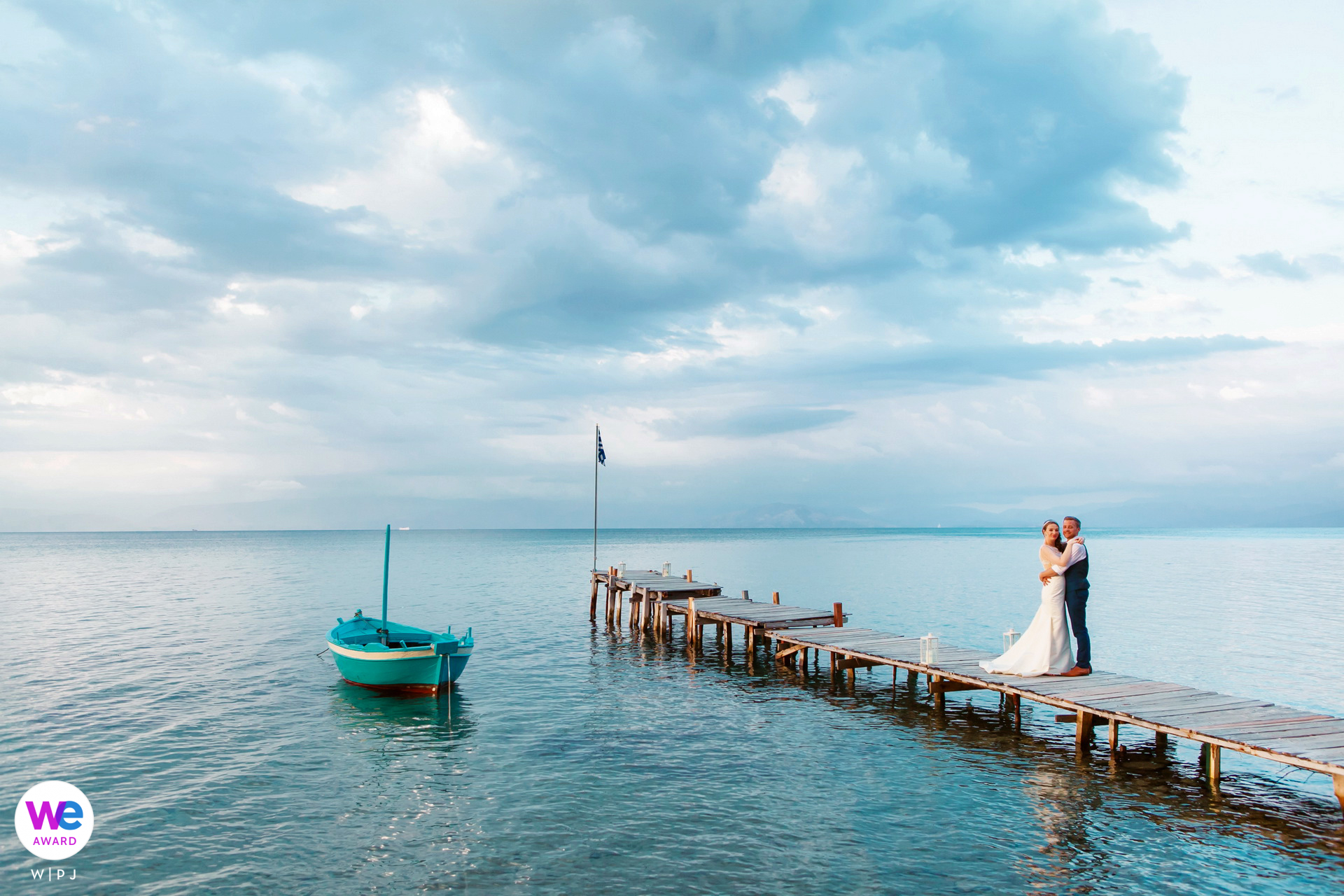 Boukari - Corfu - Ionian Islands, Greece Elopement Photo Image Award | The clouds envelop the couple in a warm embrace