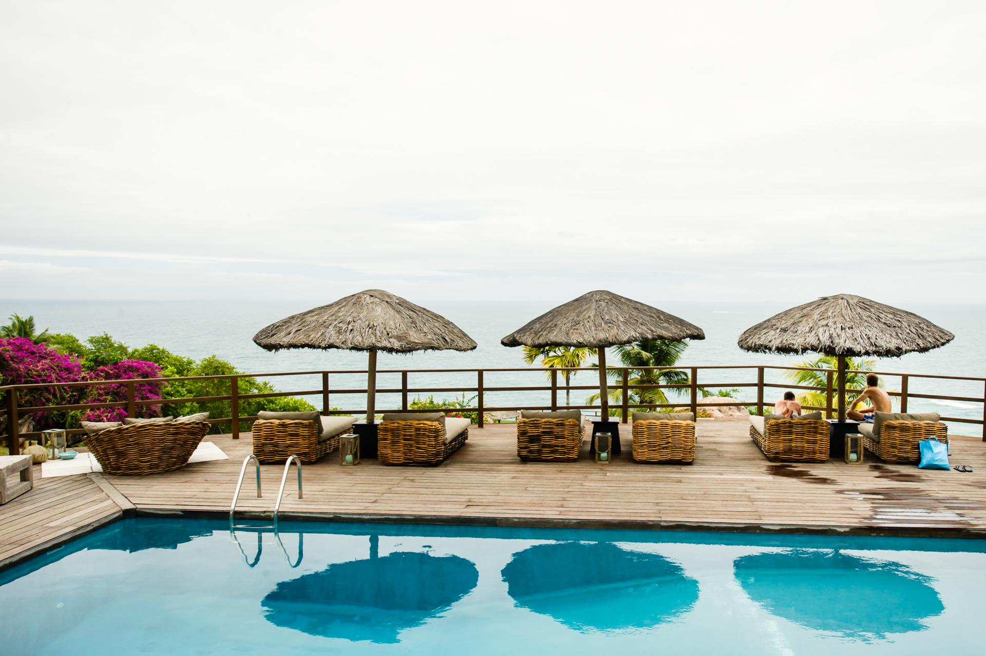 Praslin Island, Seychelles Wedding Photography | The groom and his brother take a breather next to the pool