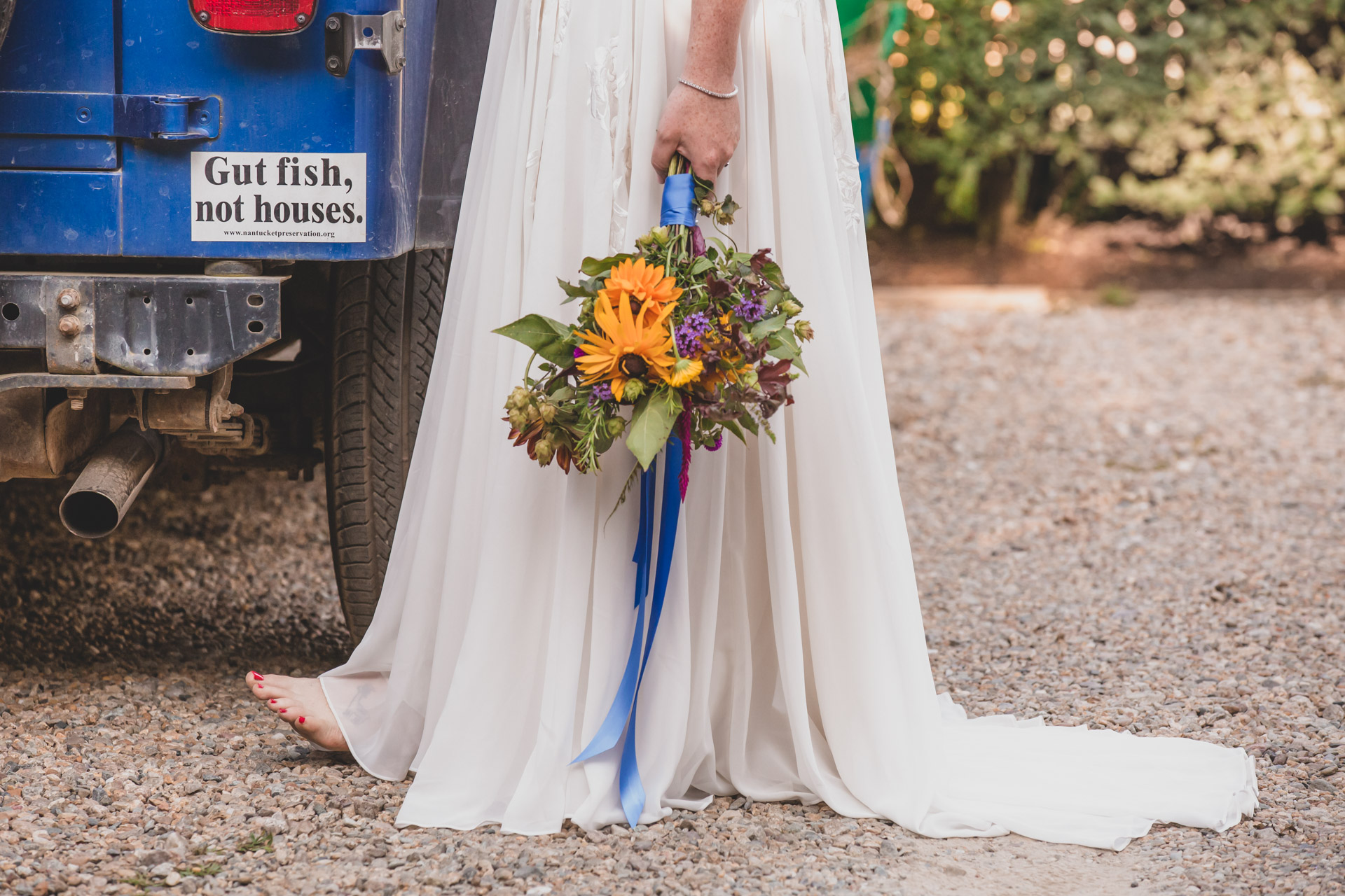 Nantucket Island Elopement Flowers, Dress Detail Image | Details of a bouquet made from the fresh farm flowers and the bride's father's old jeep